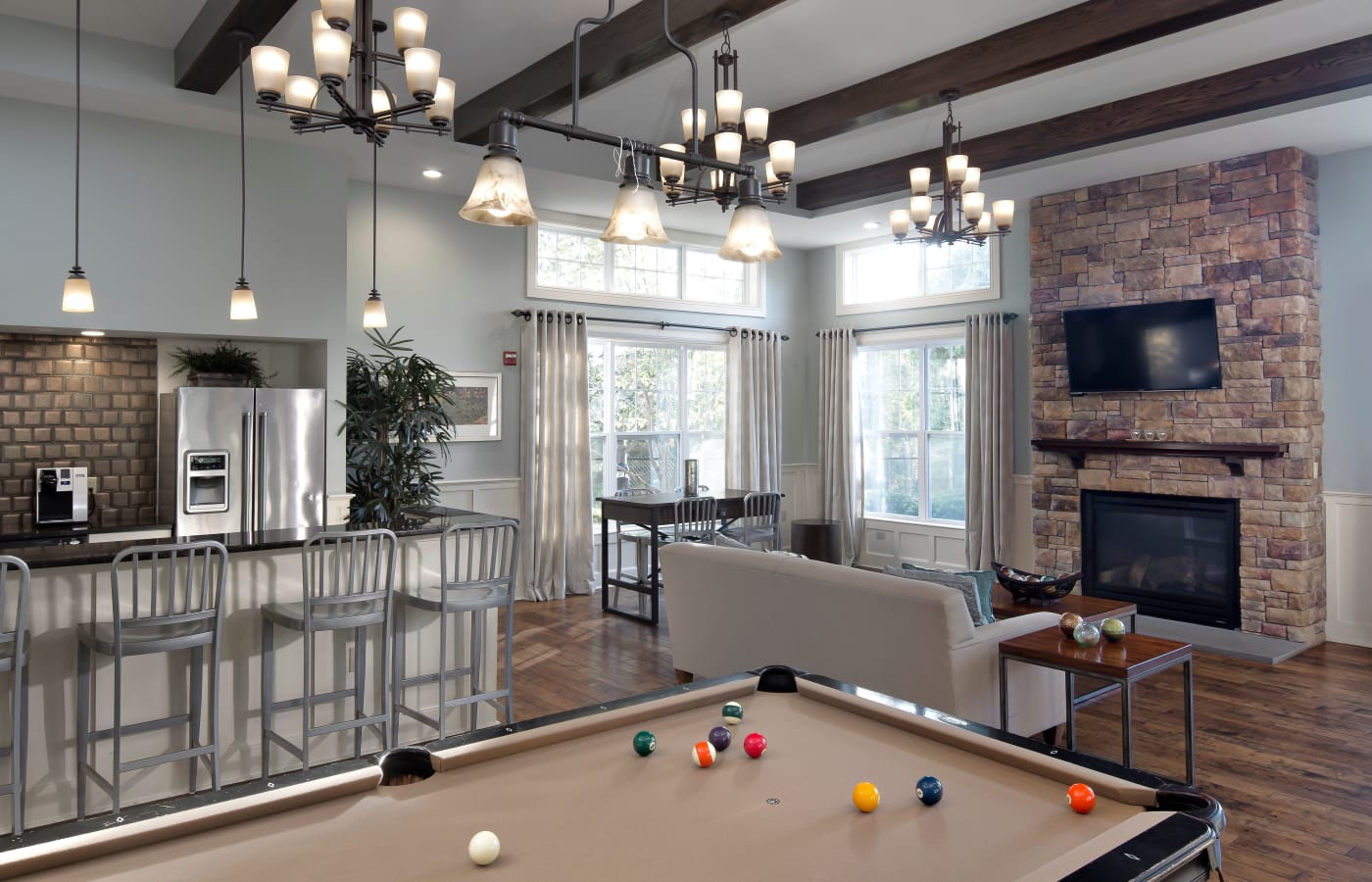 Billiards table and fireplace in the clubhouse at Prynne Hills in Canton, MA