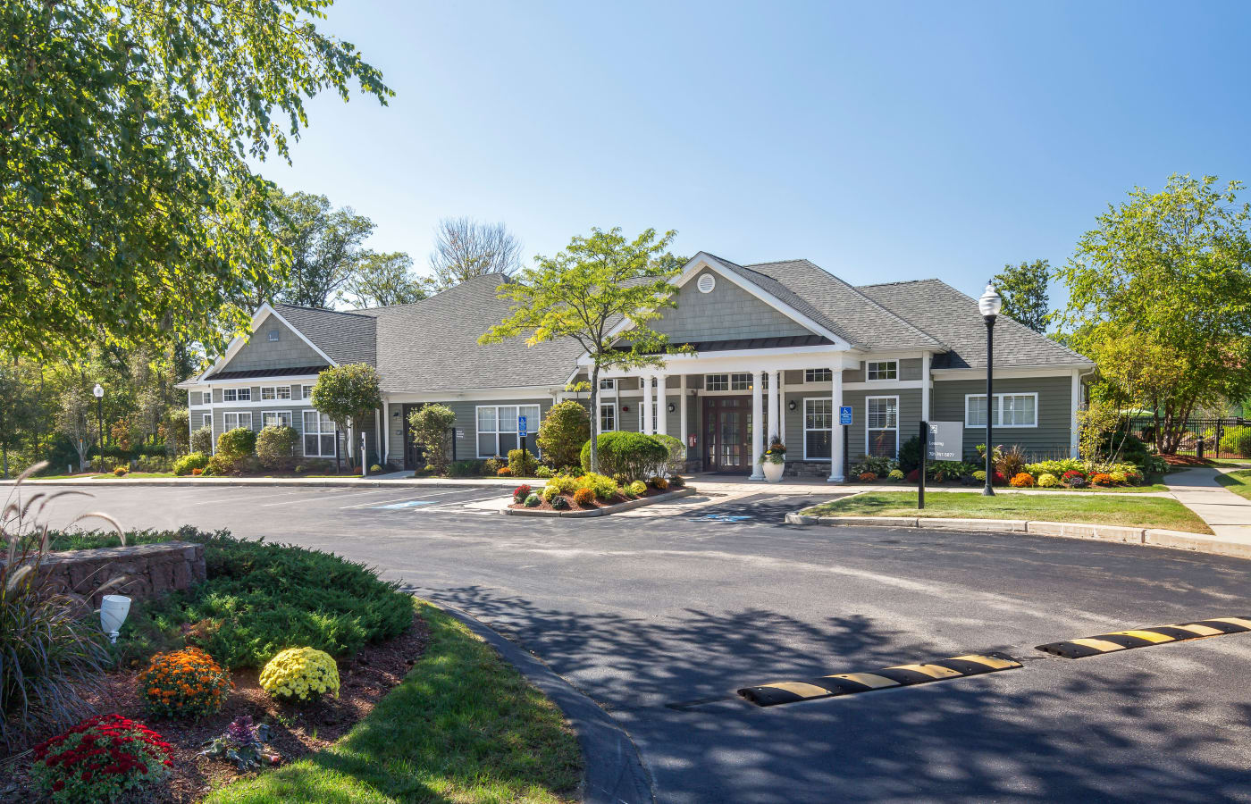 Exterior view of leasing office and well-maintained landscaping at Prynne Hills in Canton, MA