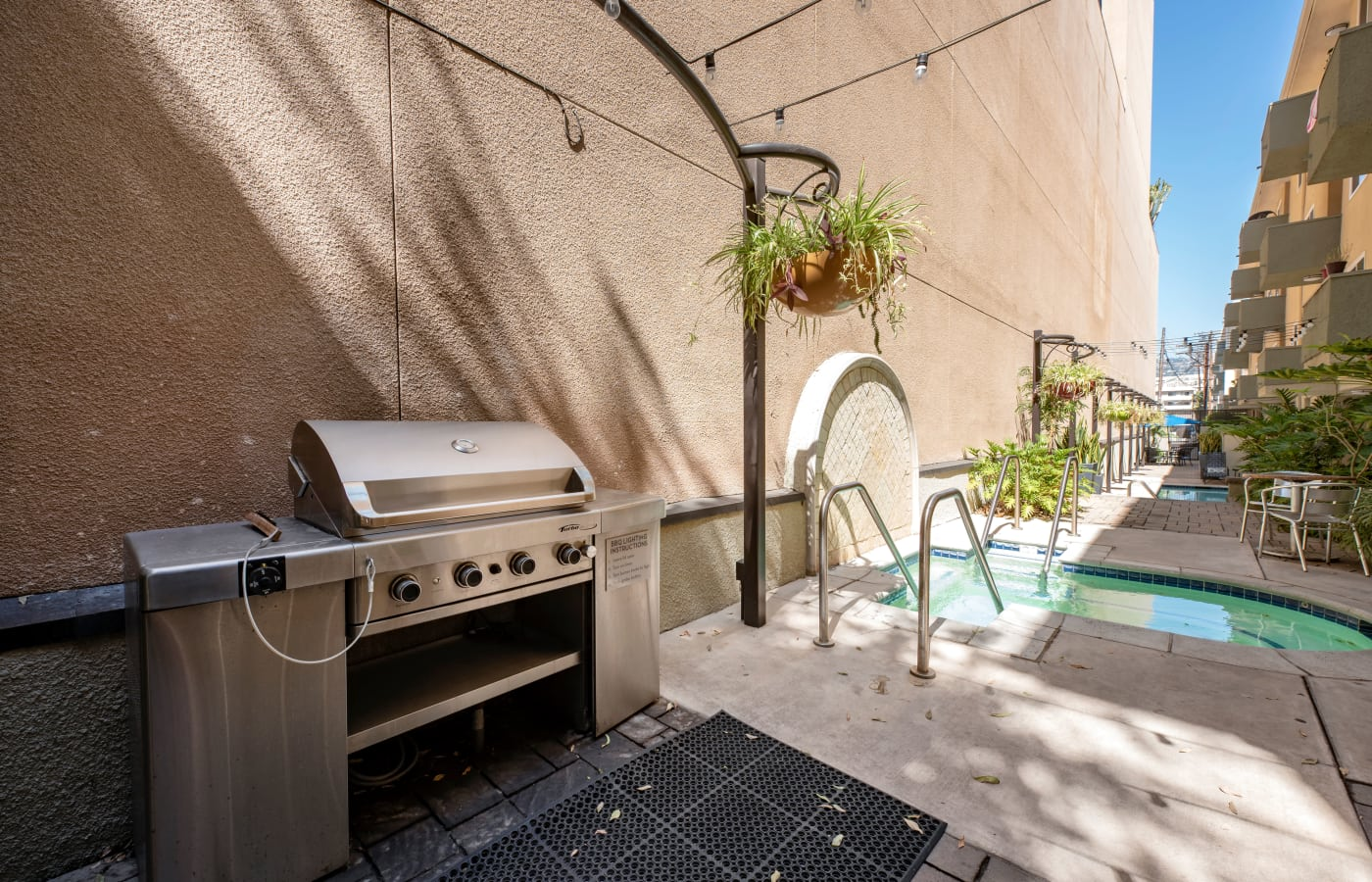 Barbecue area with gas grill at IMT Beverly Arnaz in Los Angeles, California