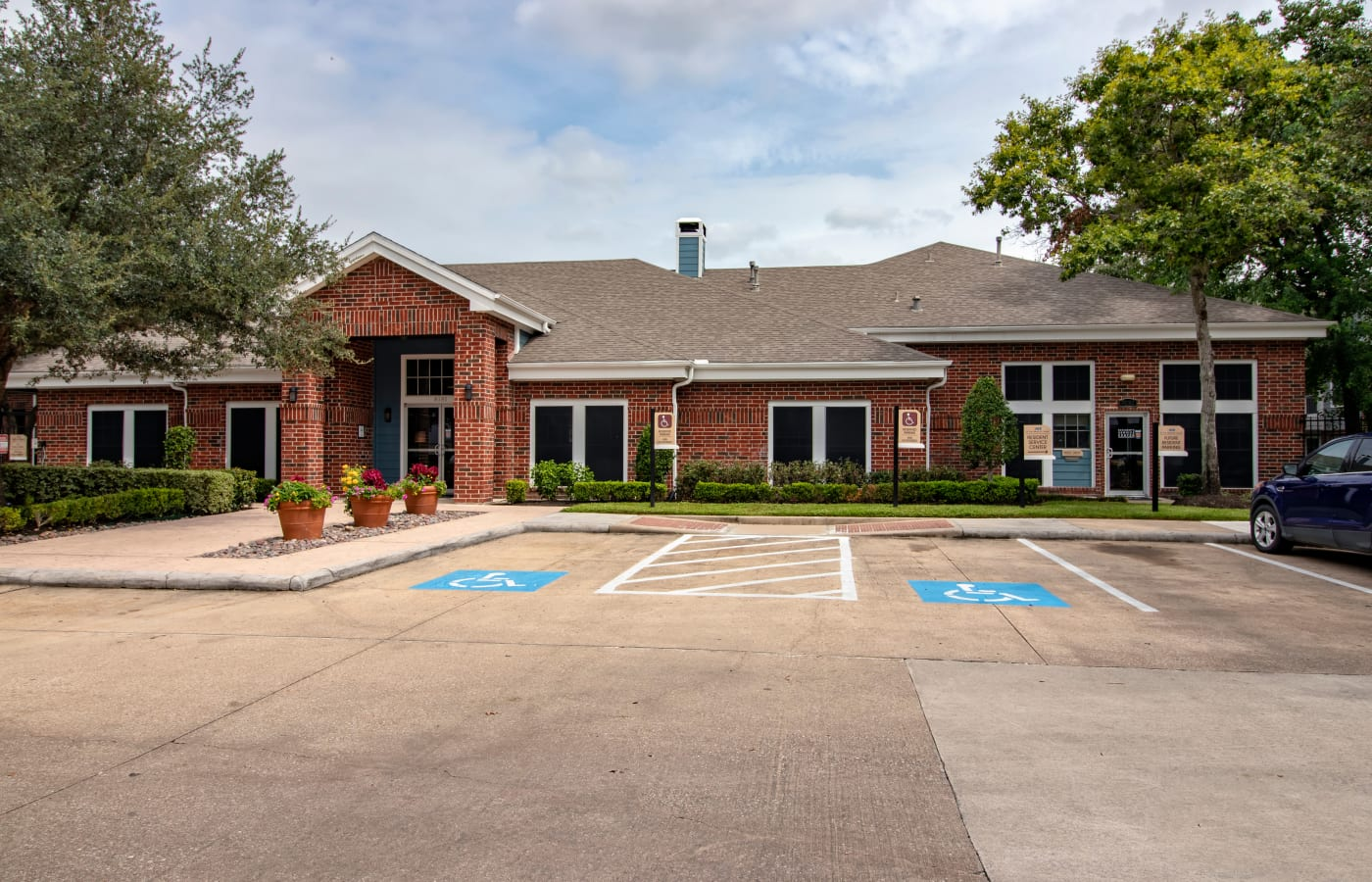 Front entrance with parking at IMT At The Medical Center in Houston, Texas