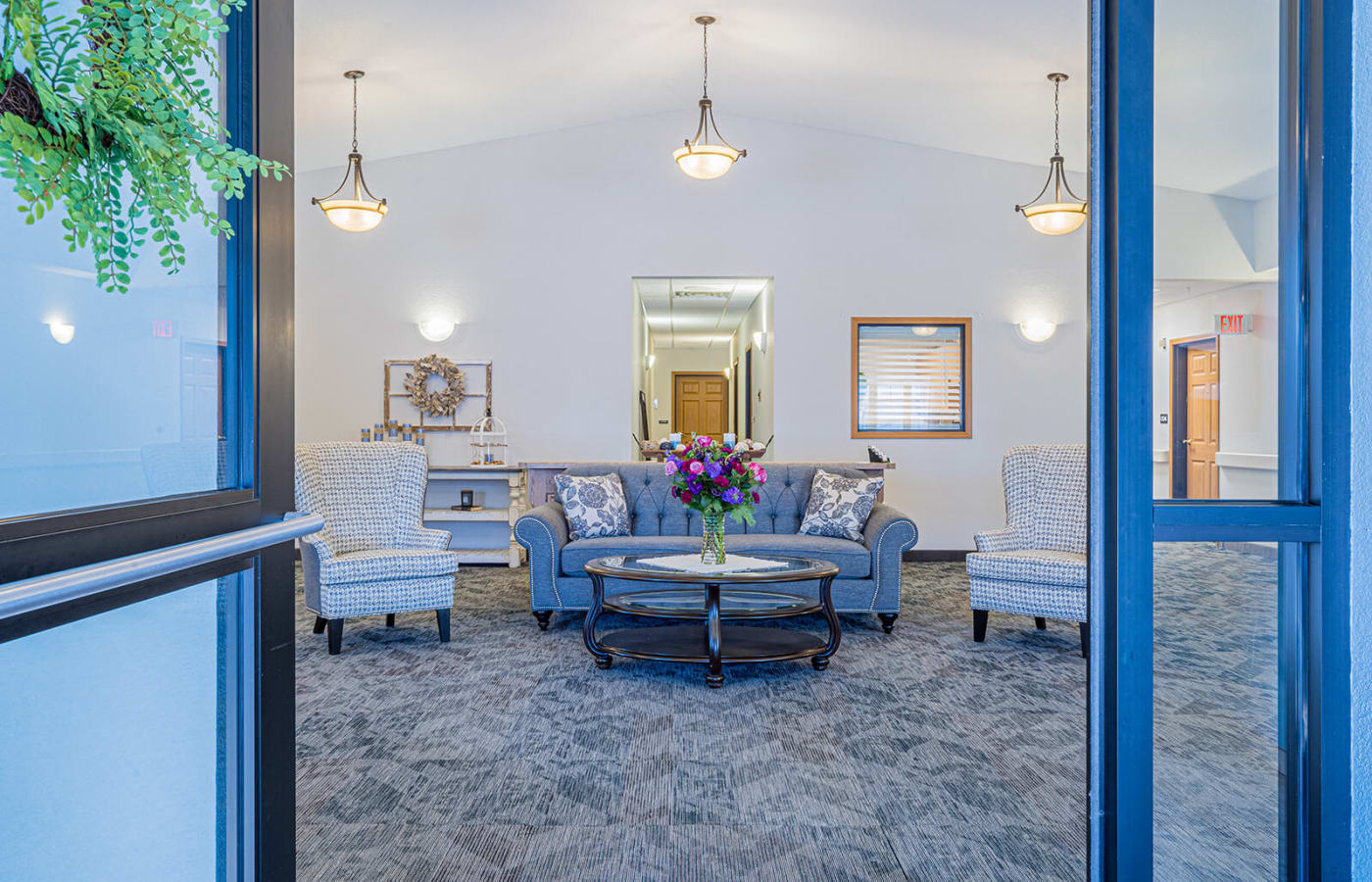 Bright and spacious lobby at Traditions of Owatonna in Owatonna, Minnesota