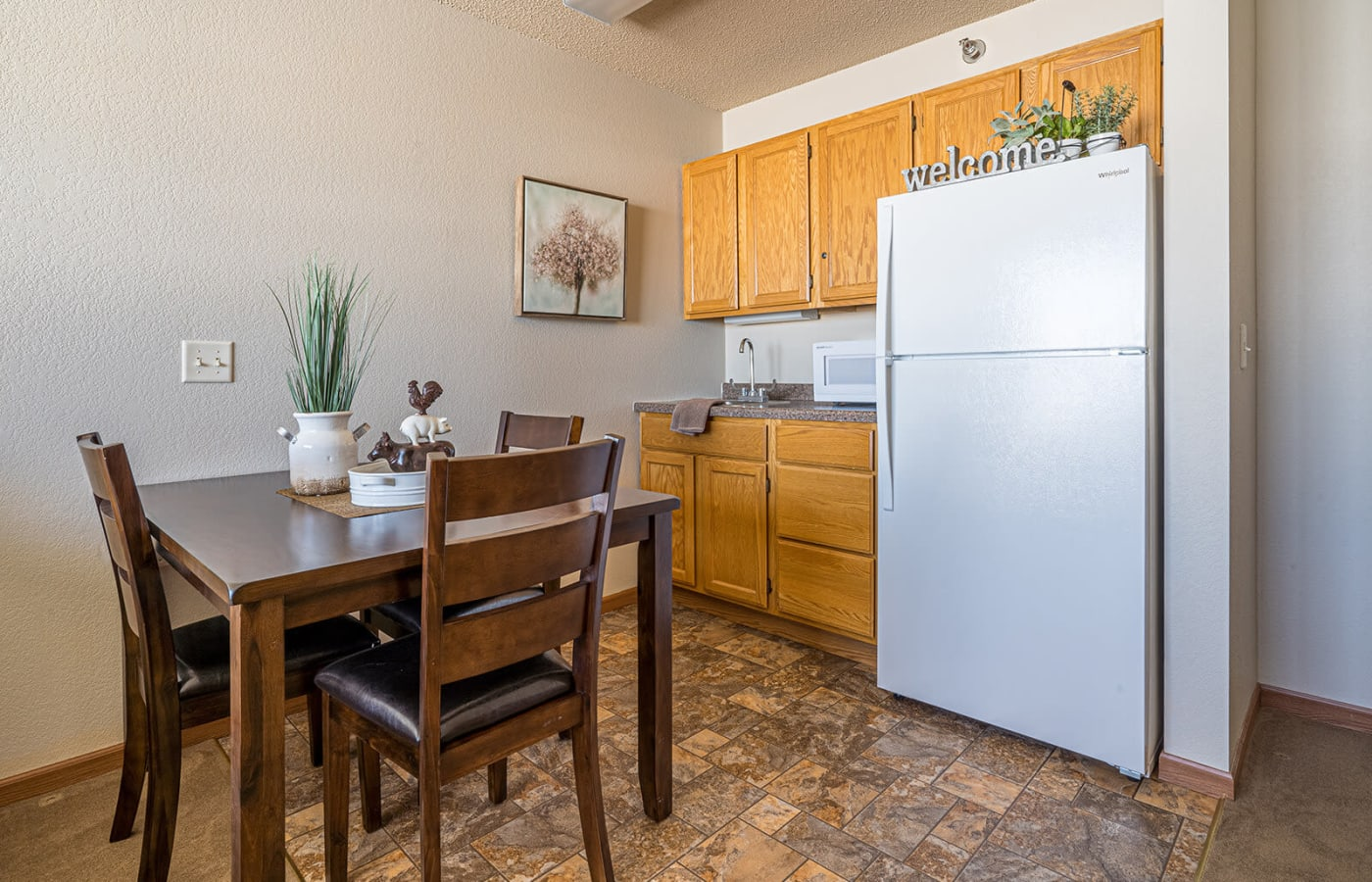 Resident apartment with kitchenette at Traditions of Owatonna in Owatonna, Minnesota