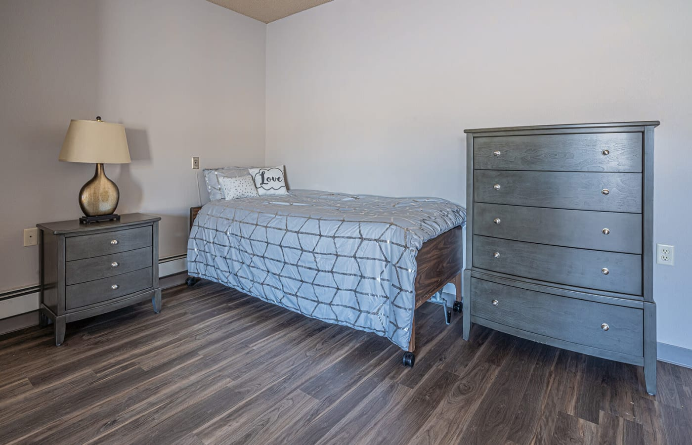 Cozy resident bedroom at Traditions of Owatonna in Owatonna, Minnesota