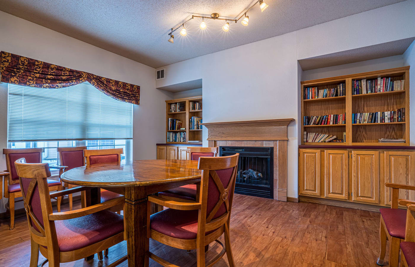 Activity room with puzzles and a fireplace at Traditions of Owatonna in Owatonna, Minnesota