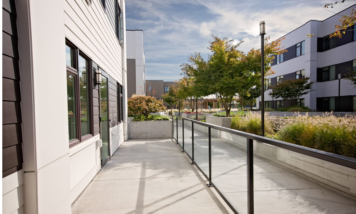Exterior walkway providing easy access to neighborhood for Grant Park Village residents in Portland, OR