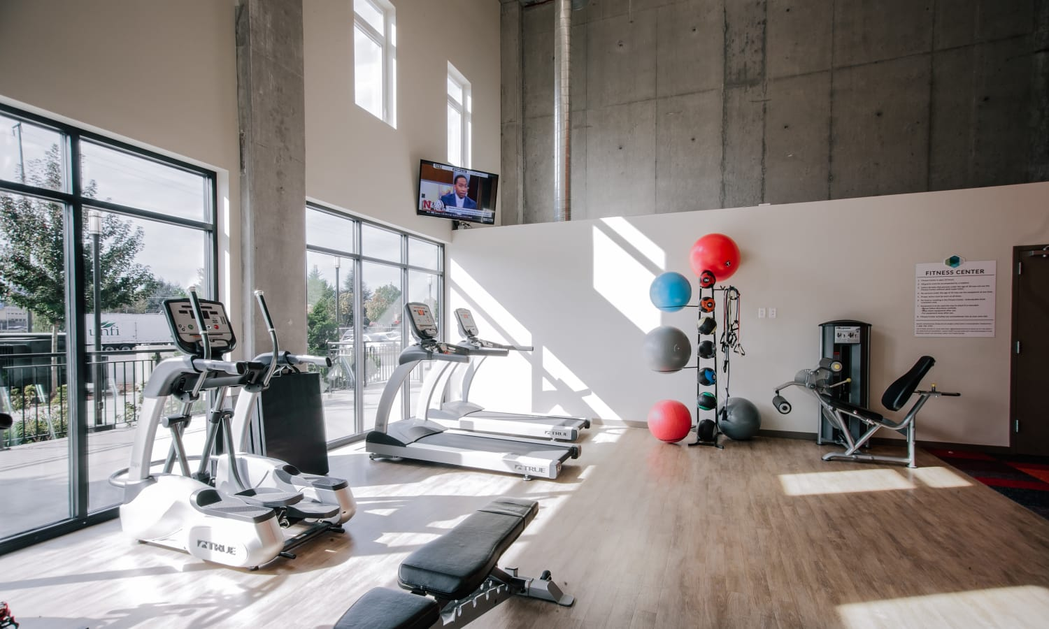 Well-equipped onsite fitness center at Grant Park Village in Portland, OR