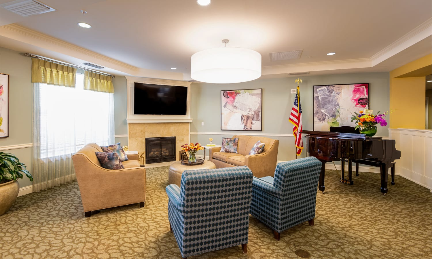 bright room with lots of seating and a tv at Prestonwood Court in Plano, Texas