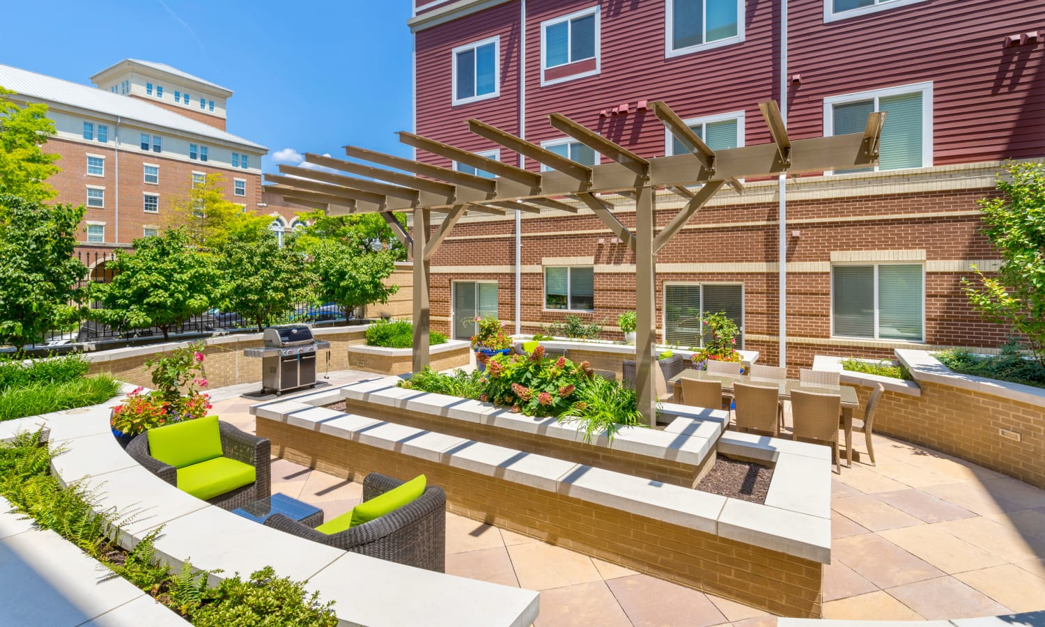 Comfortable outdoor seating and beautiful landscaping in one of the courtyards at The Bixby in Washington, District of Columbia