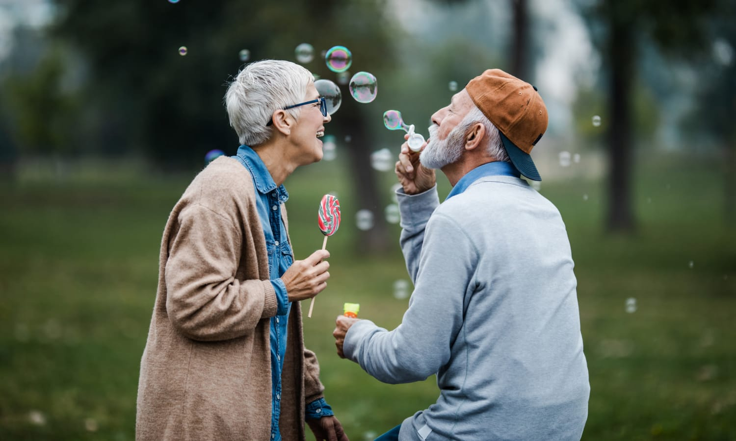 Couple blowing bubbles at Farmington Square Salem in Salem, Oregon