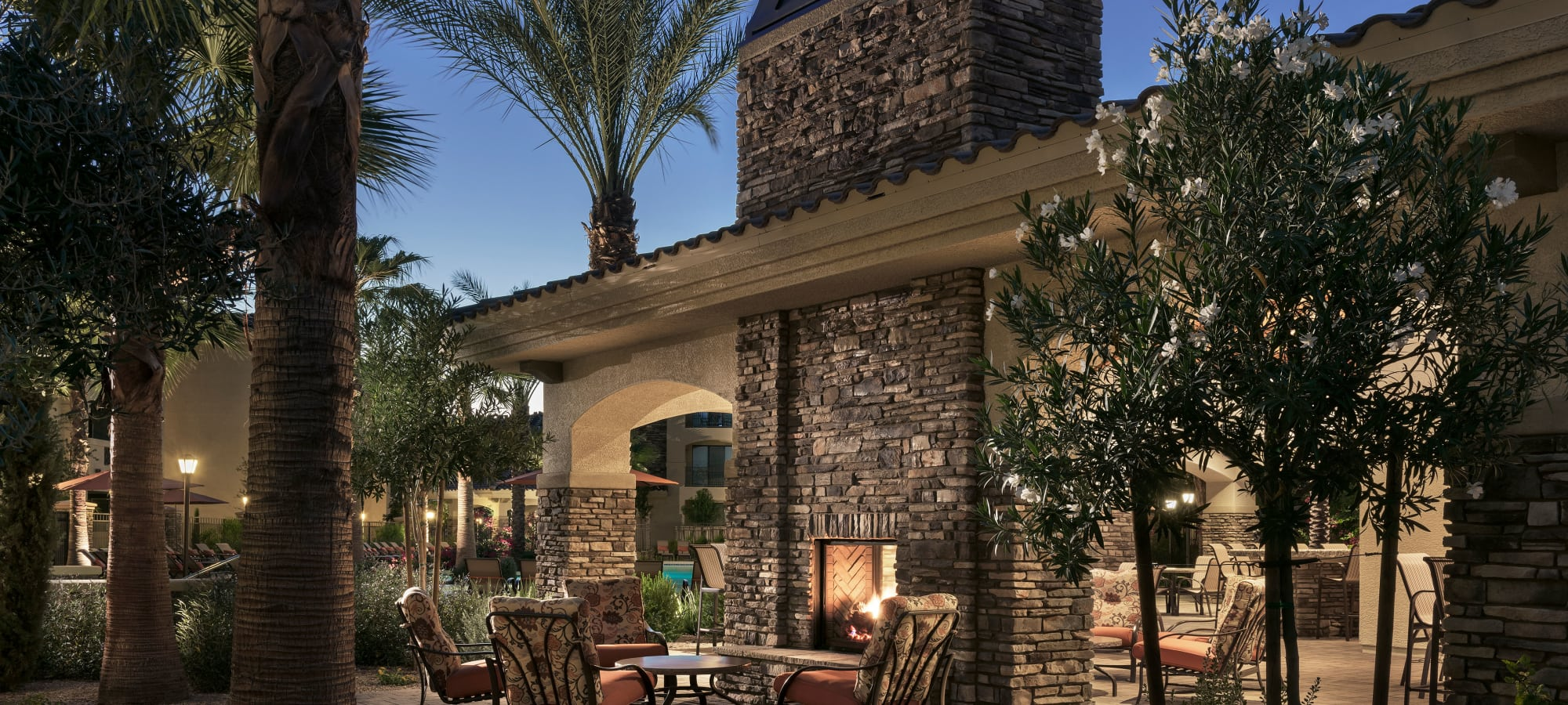 Outdoor patio at dusk at San Travesia in Scottsdale, Arizona