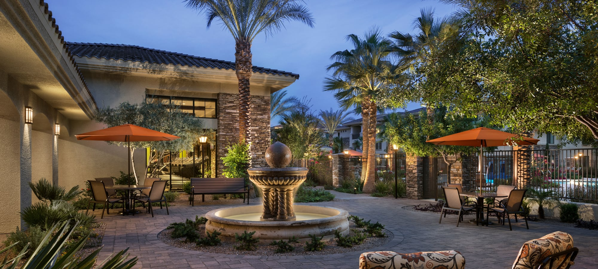 Fountain in courtyard at dusk at San Travesia in Scottsdale, Arizona