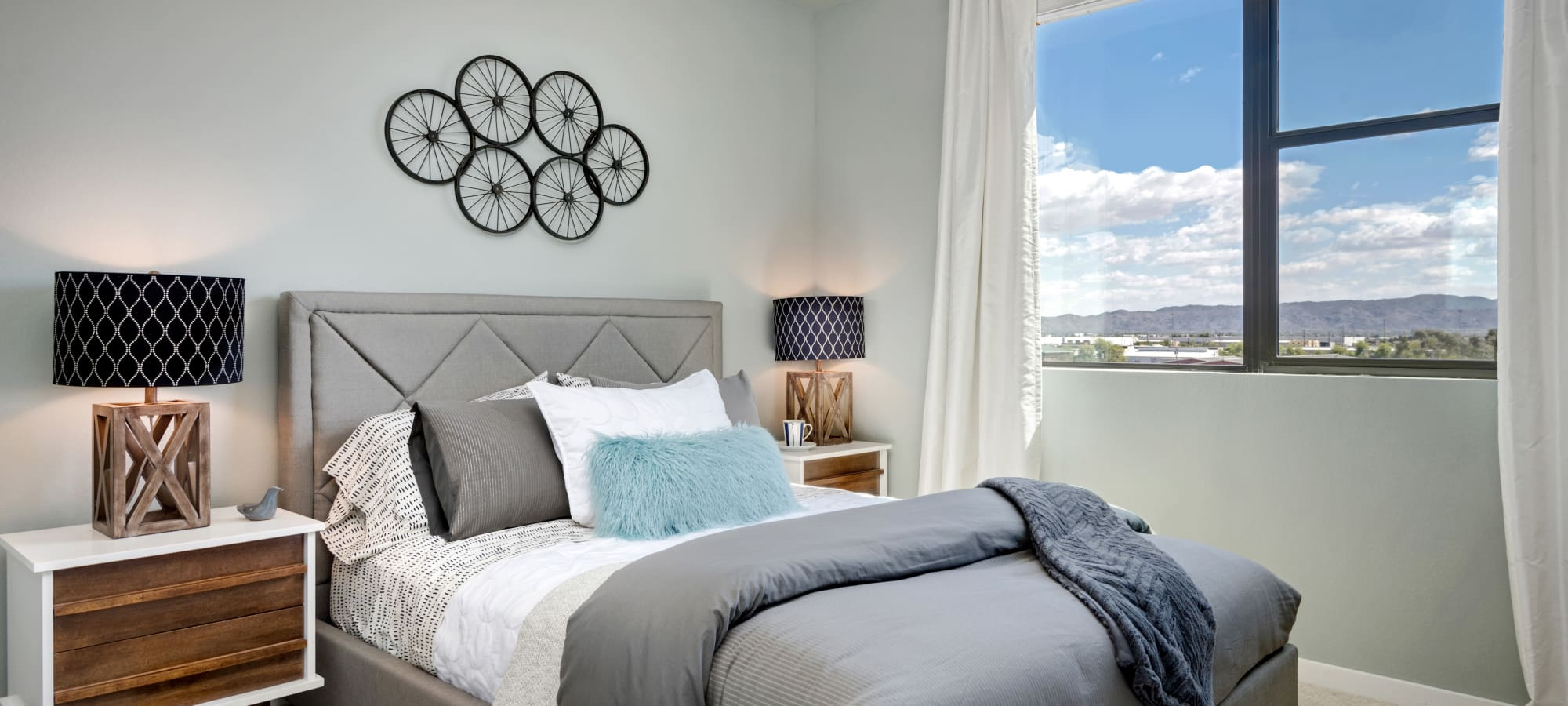 Bedroom with large bay windows in model home at Capital Place in Phoenix, Arizona
