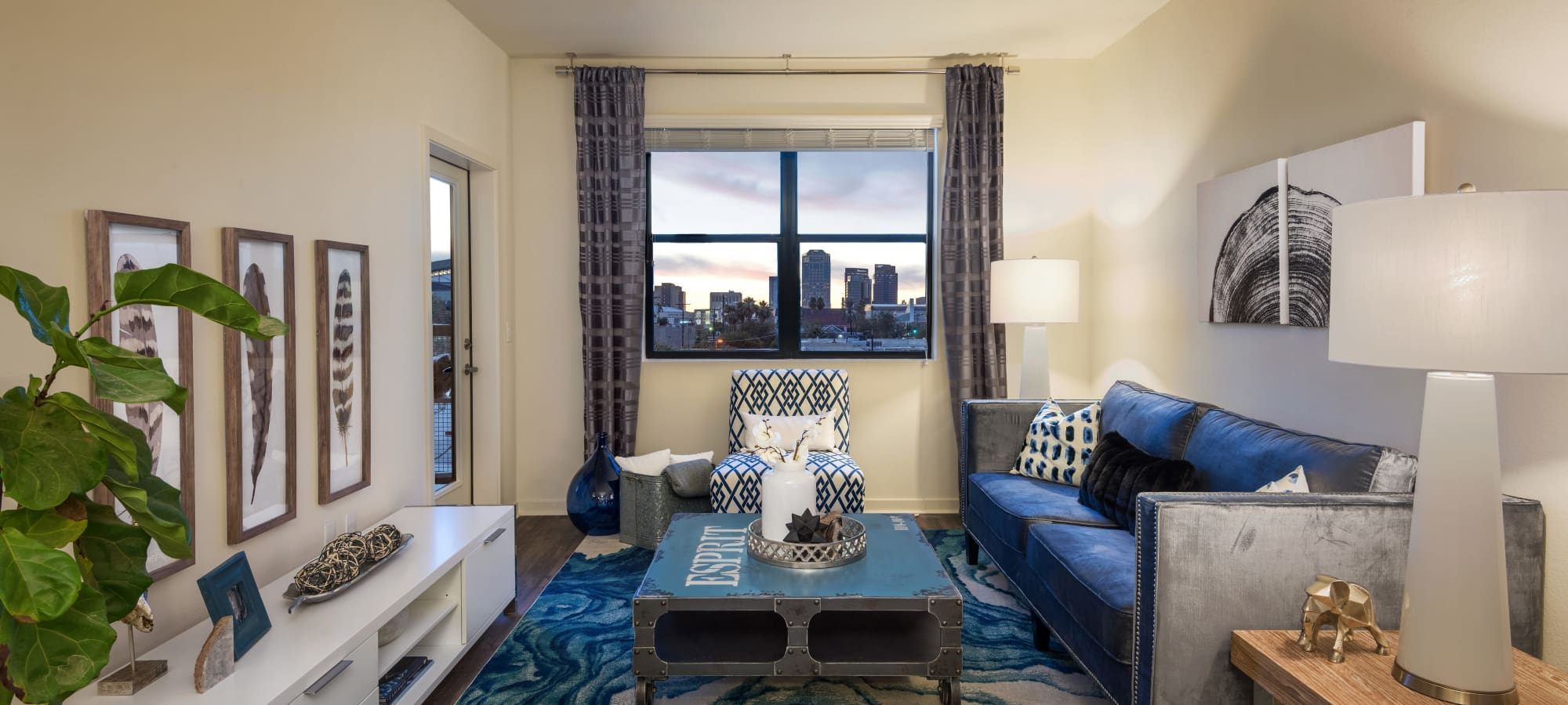 Beautiful view of the city from well-decorated model home's living room at Capital Place in Phoenix, Arizona