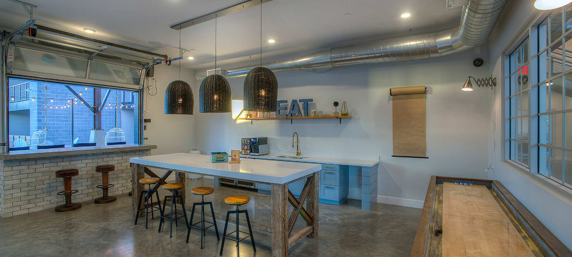 Fully equipped kitchen for resident use in the clubhouse at District Lofts in Gilbert, Arizona