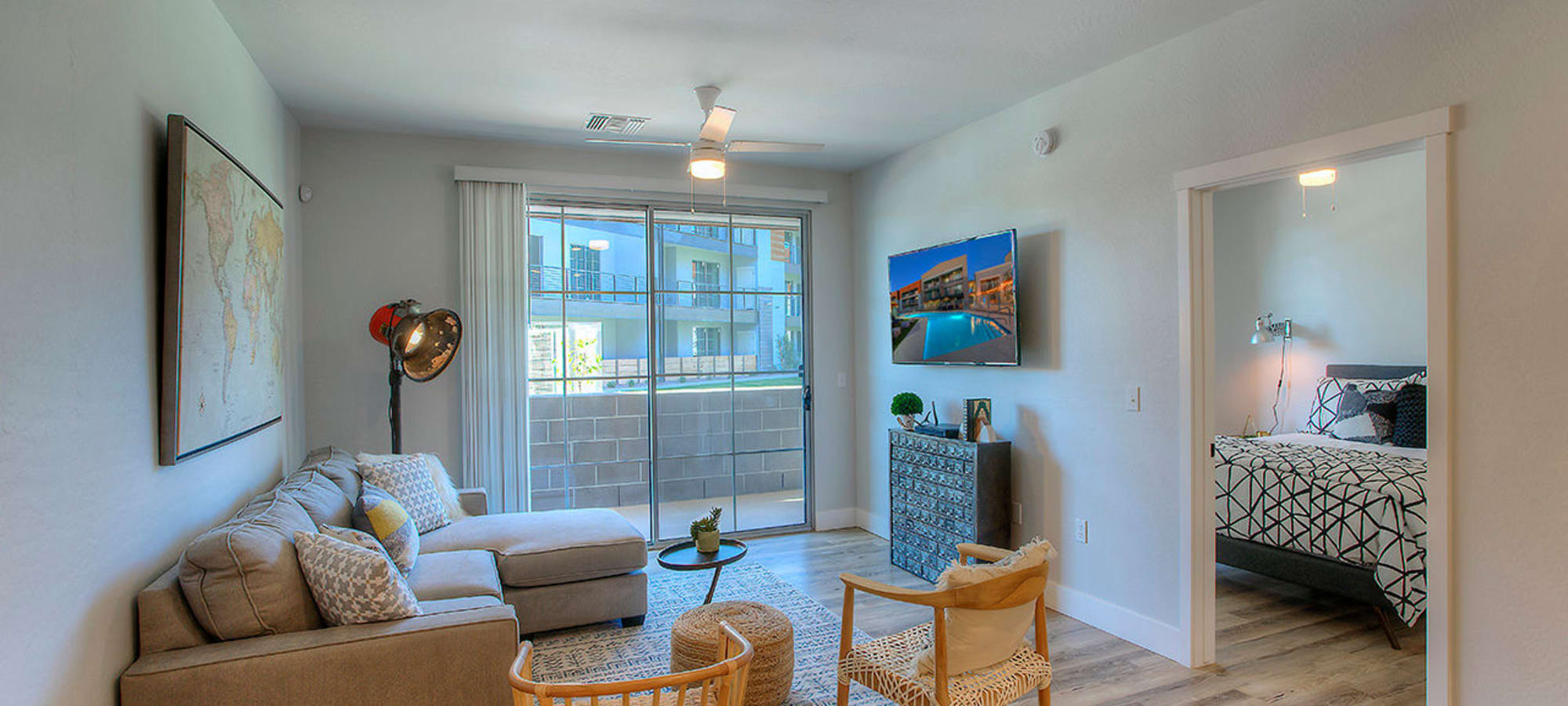 Living area looking out onto private patio of model home at District Lofts in Gilbert, Arizona