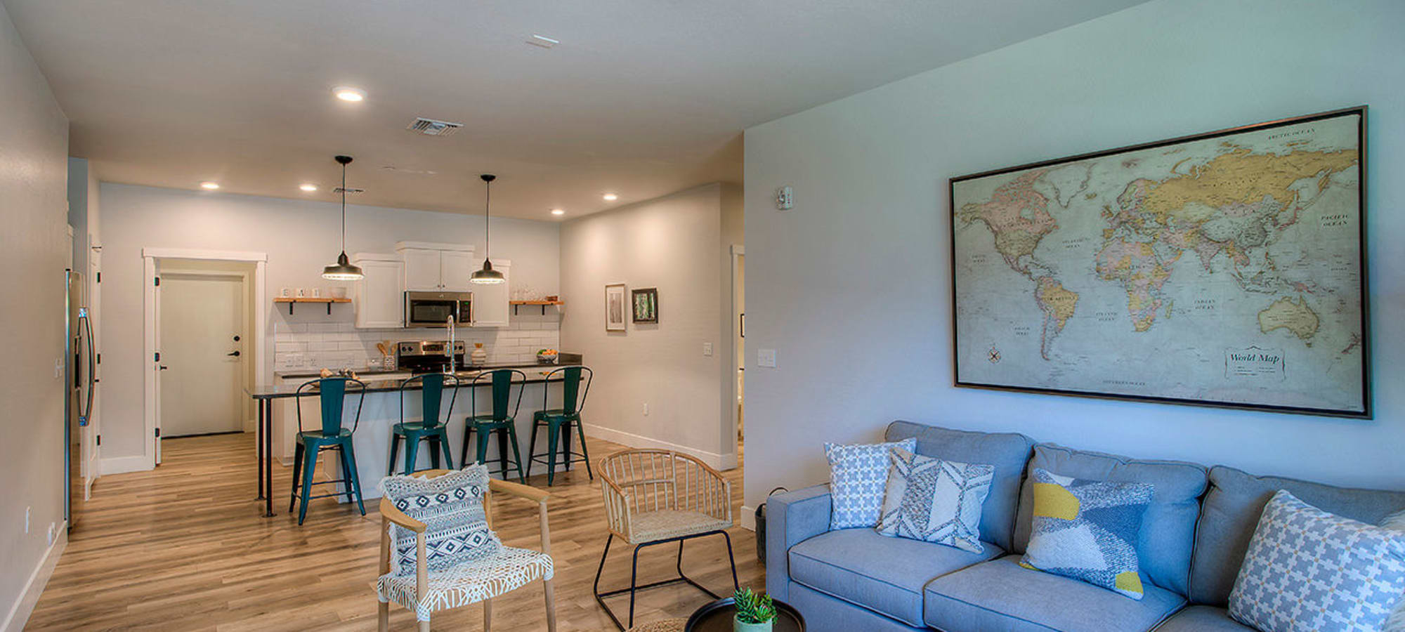 Open-concept floor plan with hardwood floors in model home at District Lofts in Gilbert, Arizona