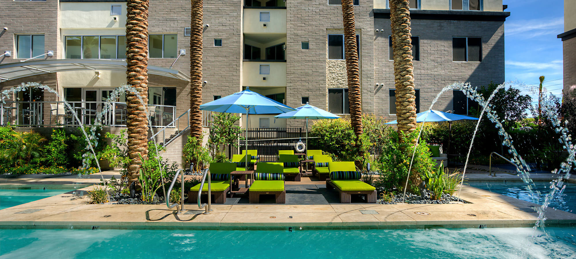 Green vegetation and fountains around the pool area at Level at Sixteenth in Phoenix, Arizona
