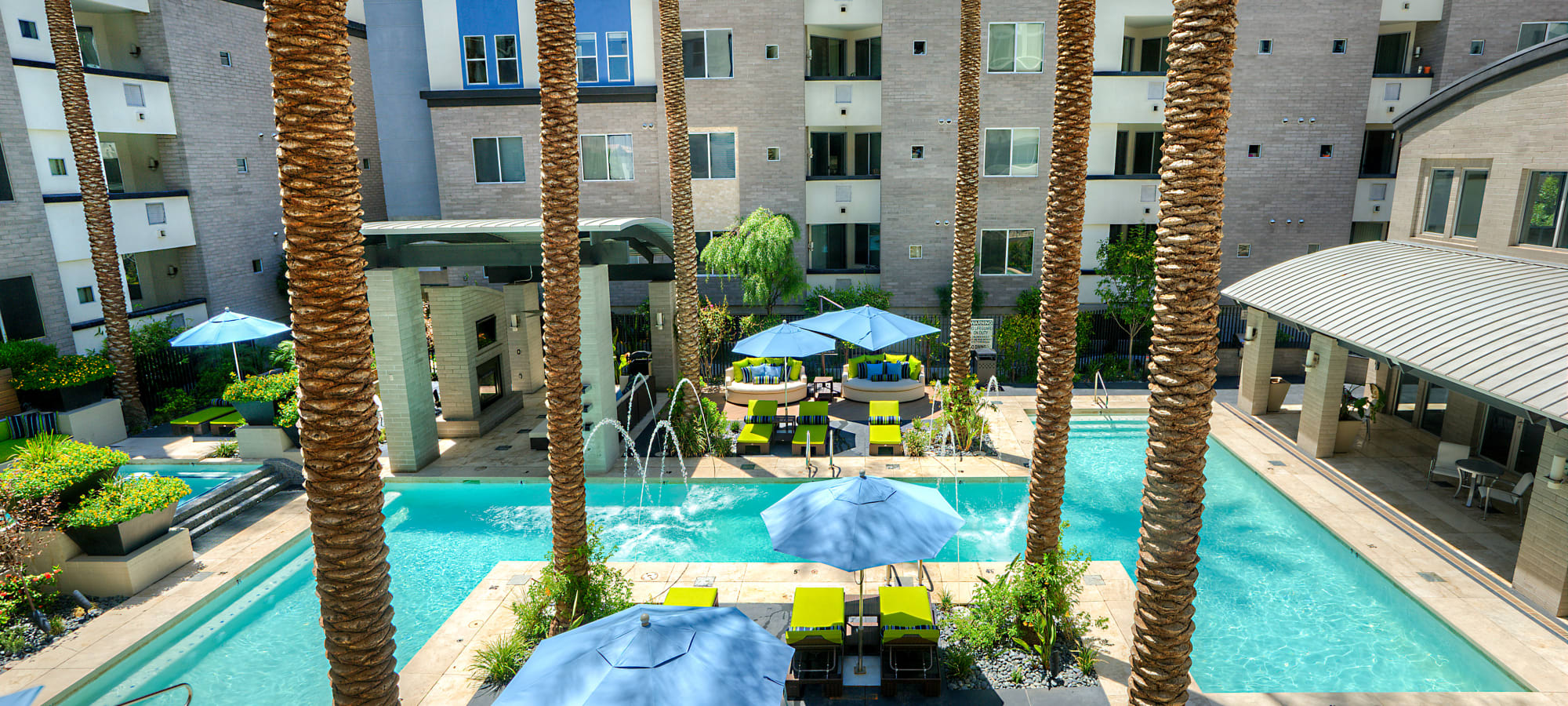 View of the swimming pool area from one of the upper-floor balconies at Level at Sixteenth in Phoenix, Arizona