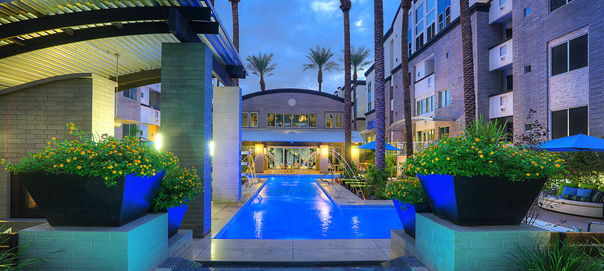 Evening view of the pool area at Level at Sixteenth in Phoenix, Arizona