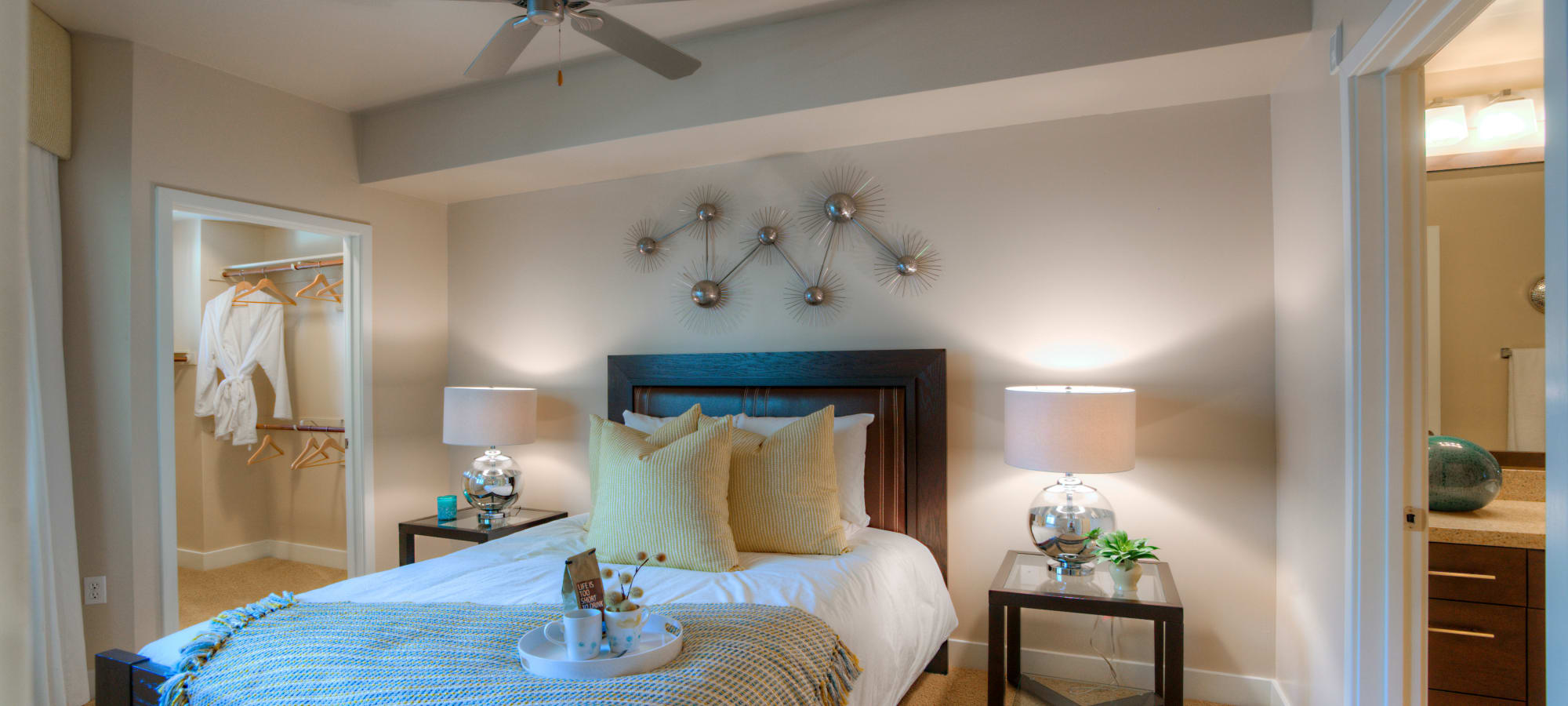 Large master bedroom with walk-in closet and en suite bathroom in model home at Level at Sixteenth in Phoenix, Arizona