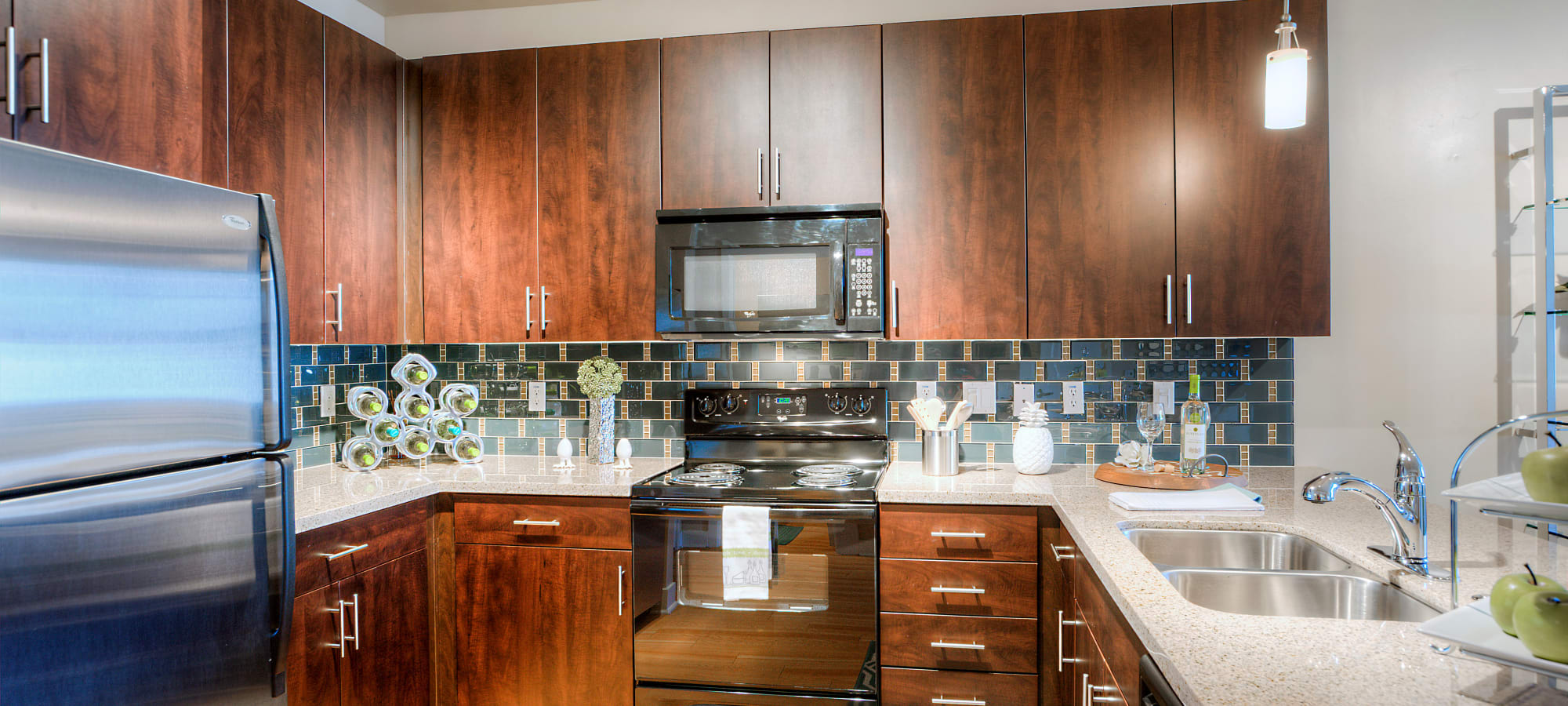 Beautiful wood cabinetry and subway tile backsplash in gourmet kitchen of model home at Level at Sixteenth in Phoenix, Arizona
