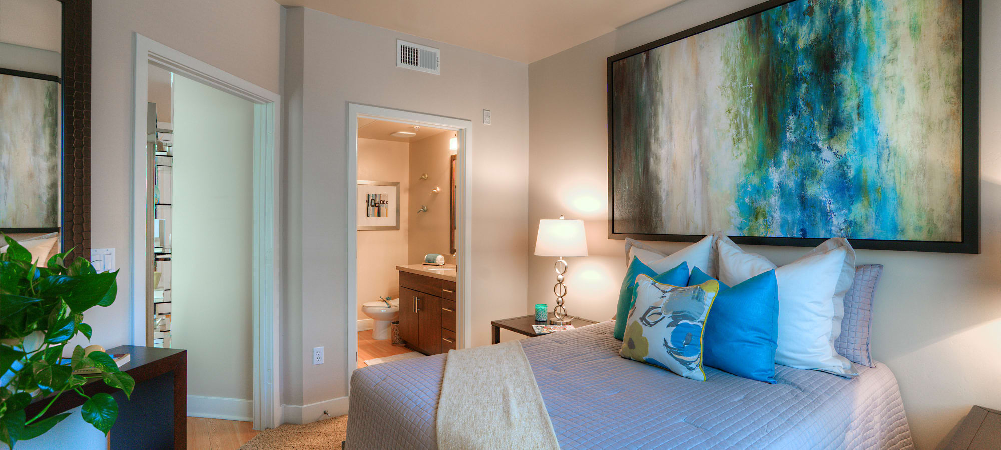 Guest bedroom with en suite bathroom in model home at Level at Sixteenth in Phoenix, Arizona