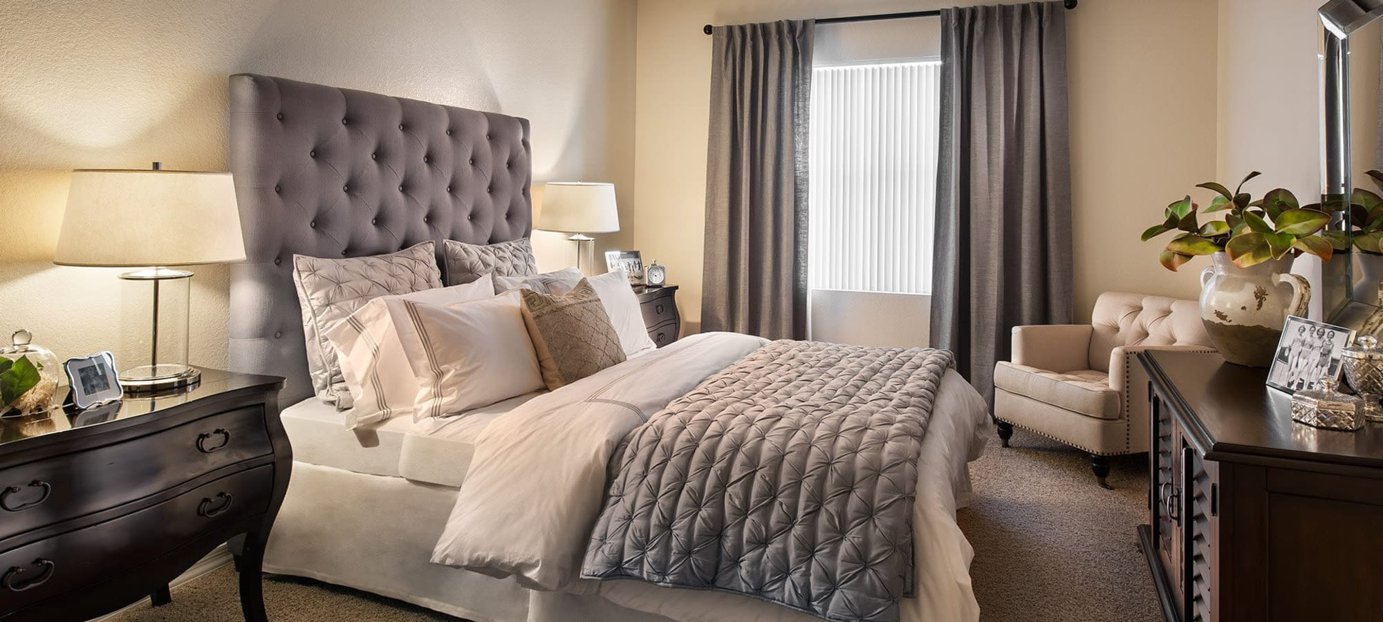 Well-decorated master bedroom in model home at San Milan in Phoenix, Arizona