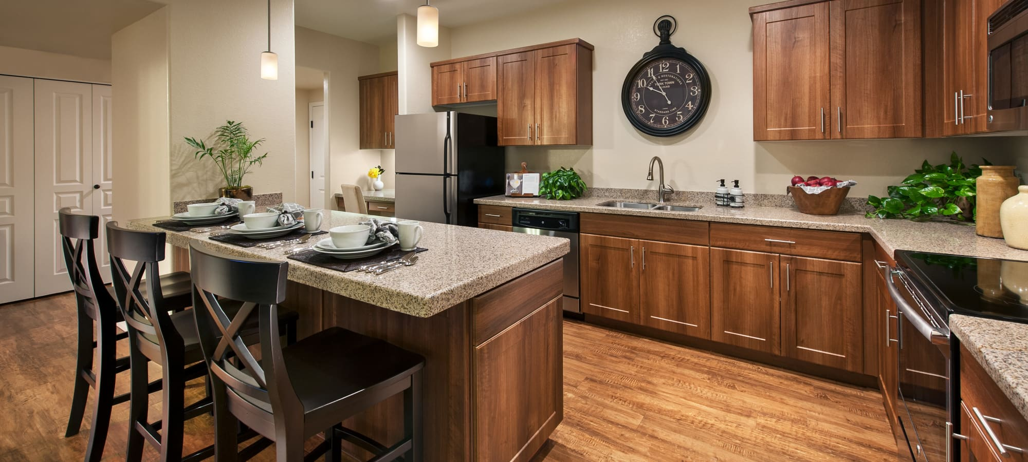 Kitchen with island and hardwood floors in model home at San Paseo in Phoenix, Arizona