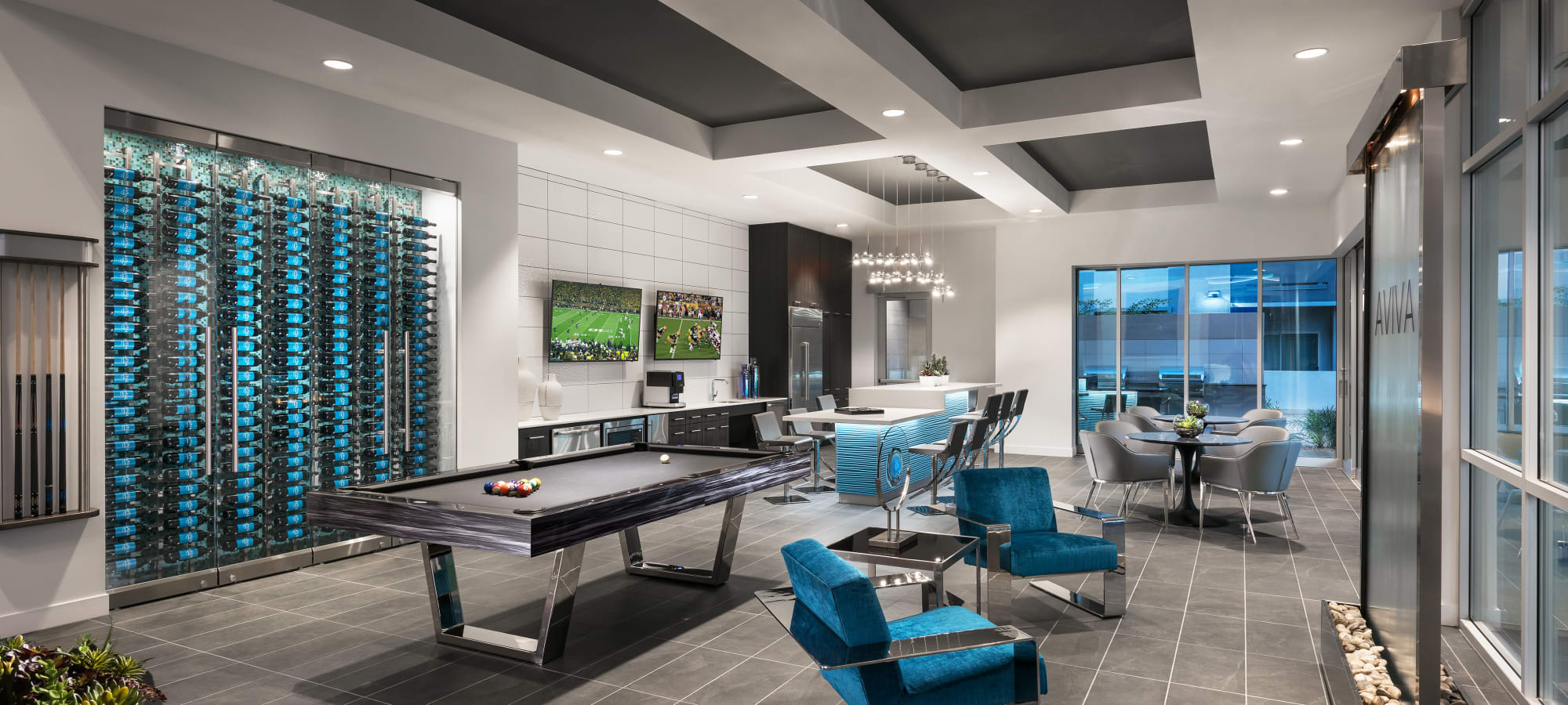 Clubhouse pool table and indoor waterfall at Aviva in Mesa, Arizona