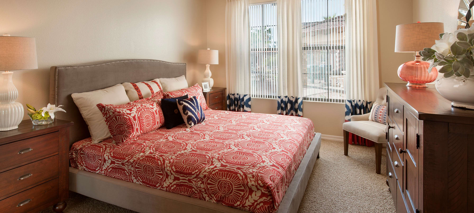 Bedroom with large windows in model home at San Capella in Tempe, Arizona
