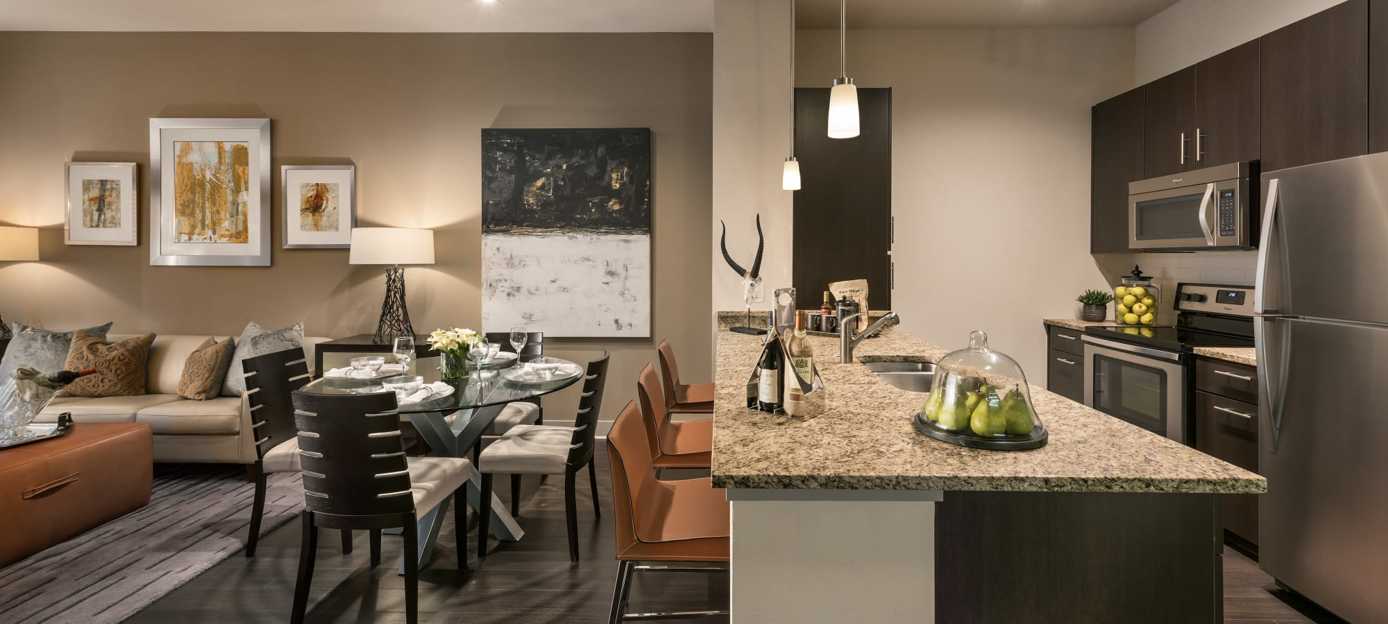 Open kitchen with breakfast bar at Emerson Mill Avenue in Tempe, Arizona