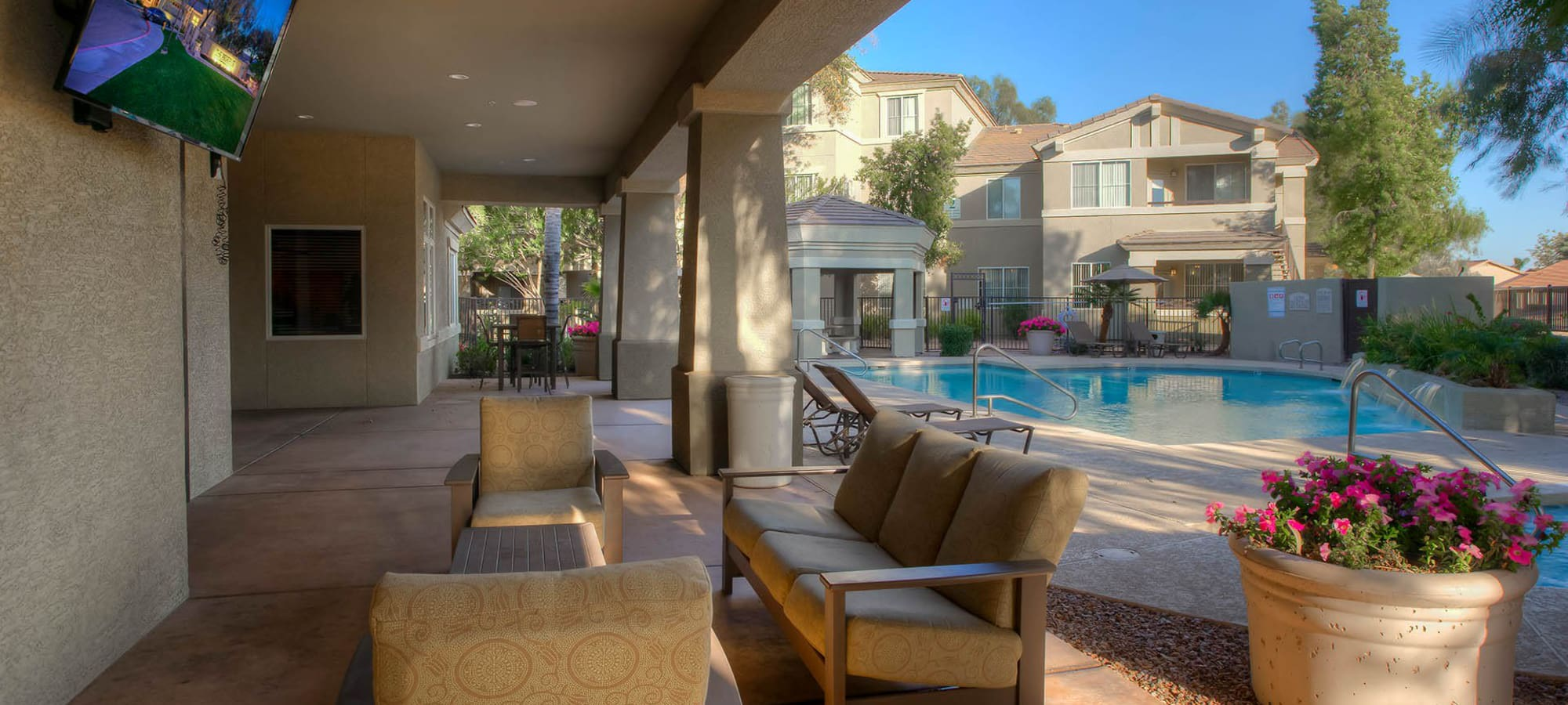 Covered seating area close to the swimming pool at The Reserve at Gilbert Towne Centre in Gilbert, Arizona