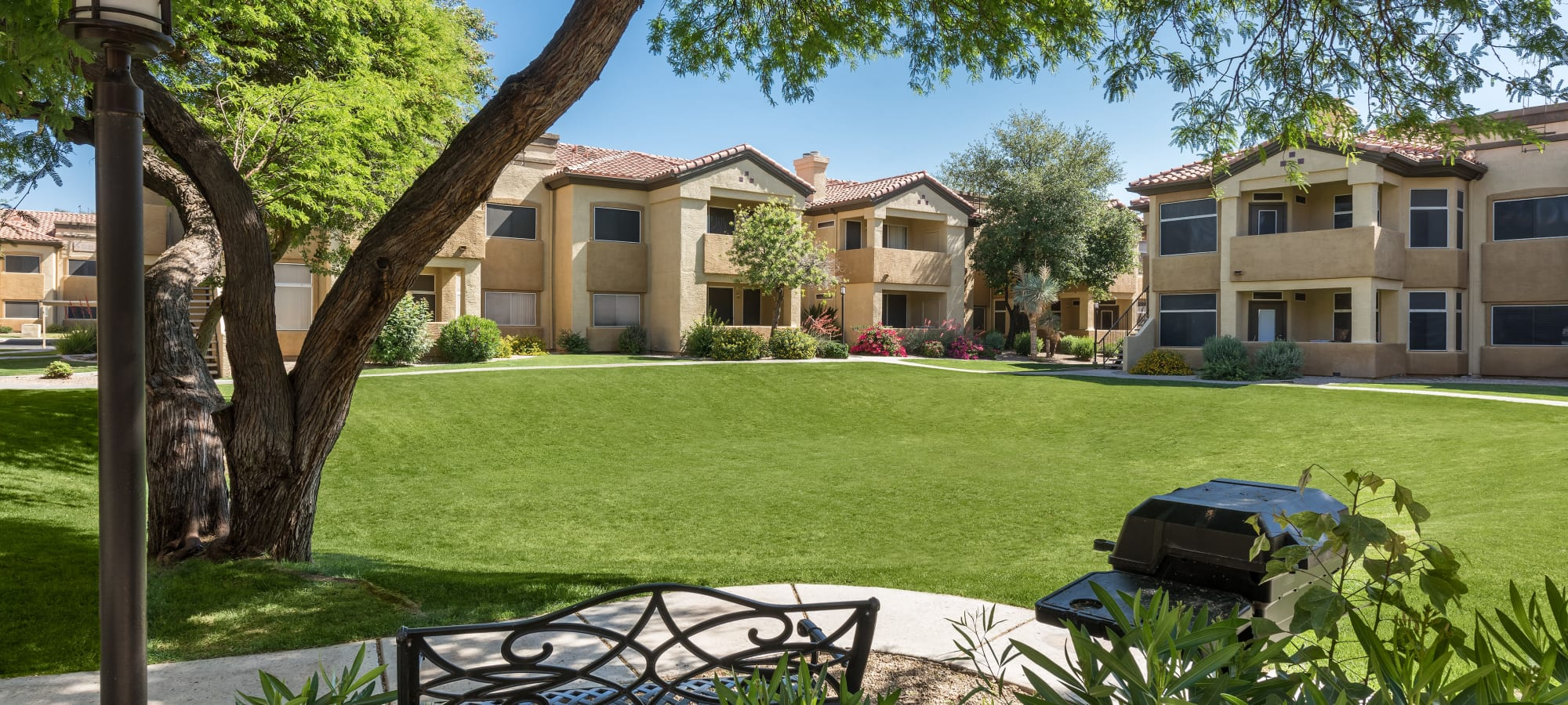 Outdoor picnic area with grill at Bellagio in Scottsdale, Arizona