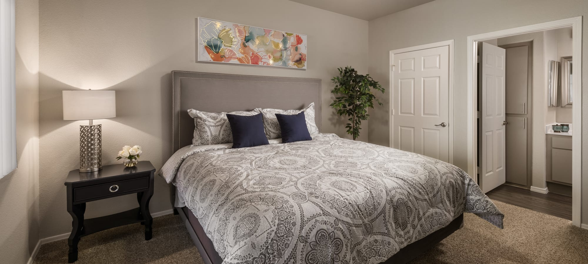 Bedroom with walk-in closets in model home at Bellagio in Scottsdale, Arizona