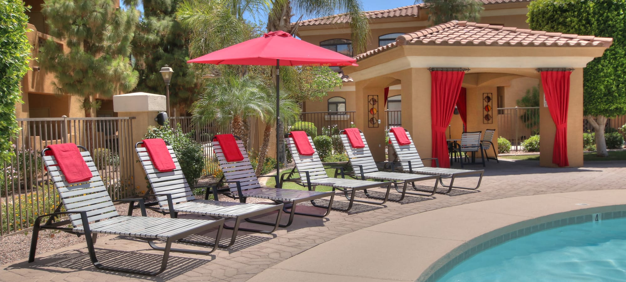 Poolside lounging and covered seating at The Retreat at the Raven in Phoenix, Arizona