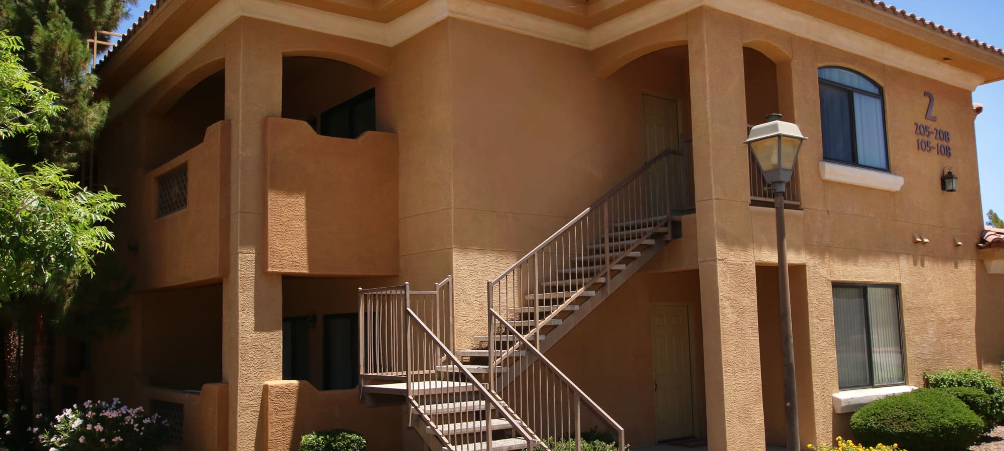 Stairs leading into entry of apartment in Phoenix, Arizona at The Retreat at the Raven