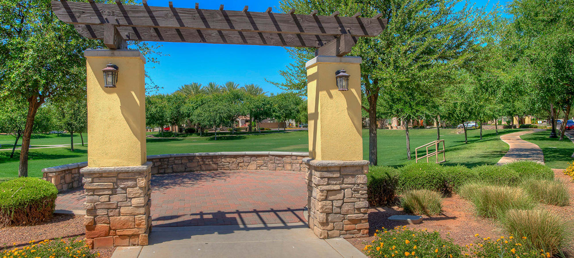 Archway into open fields at BB Living at Higley Park in Gilbert, Arizona