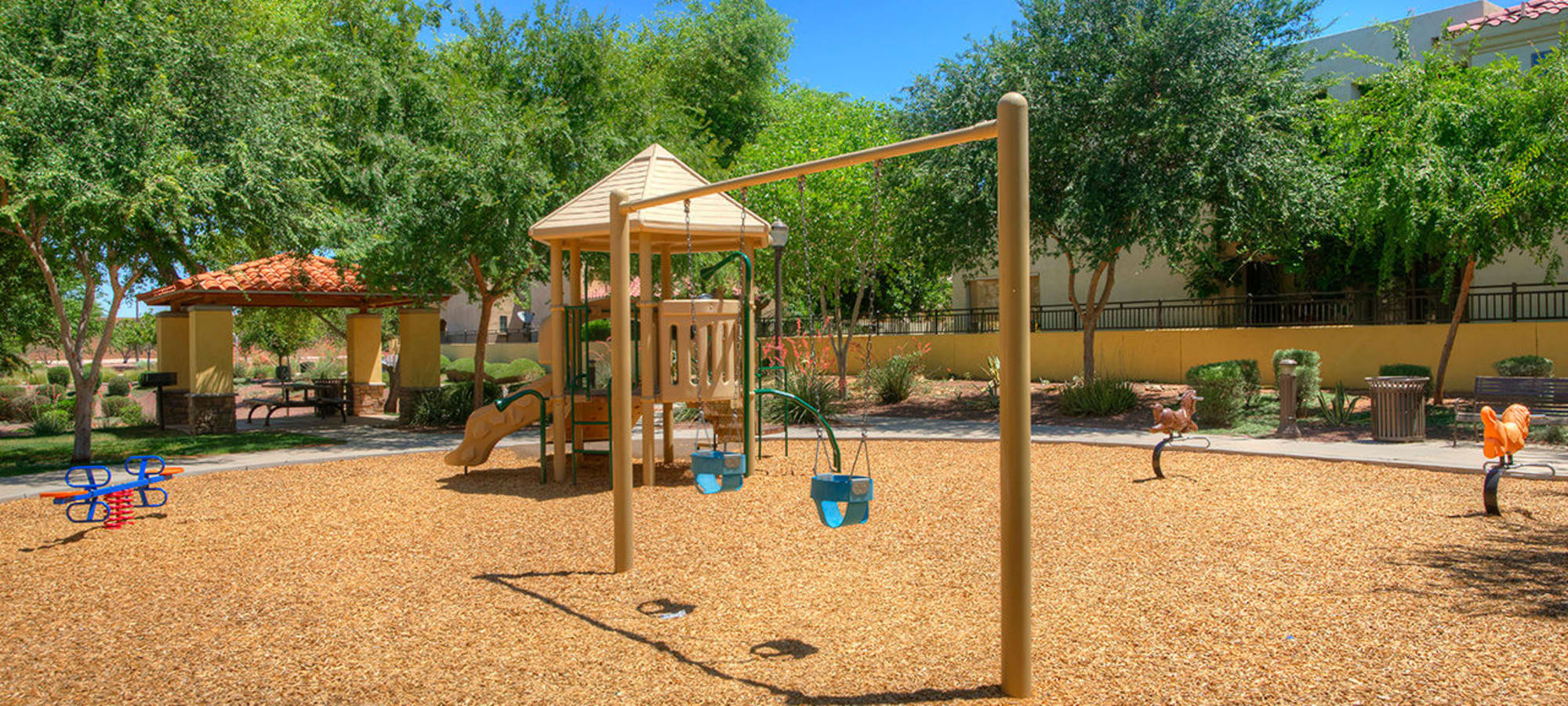 Swings at the playground in Gilbert, Arizona at BB Living at Higley Park