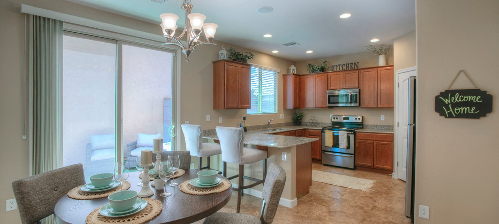 Decorated dining room table in model home at BB Living at Higley Park in Gilbert, Arizona