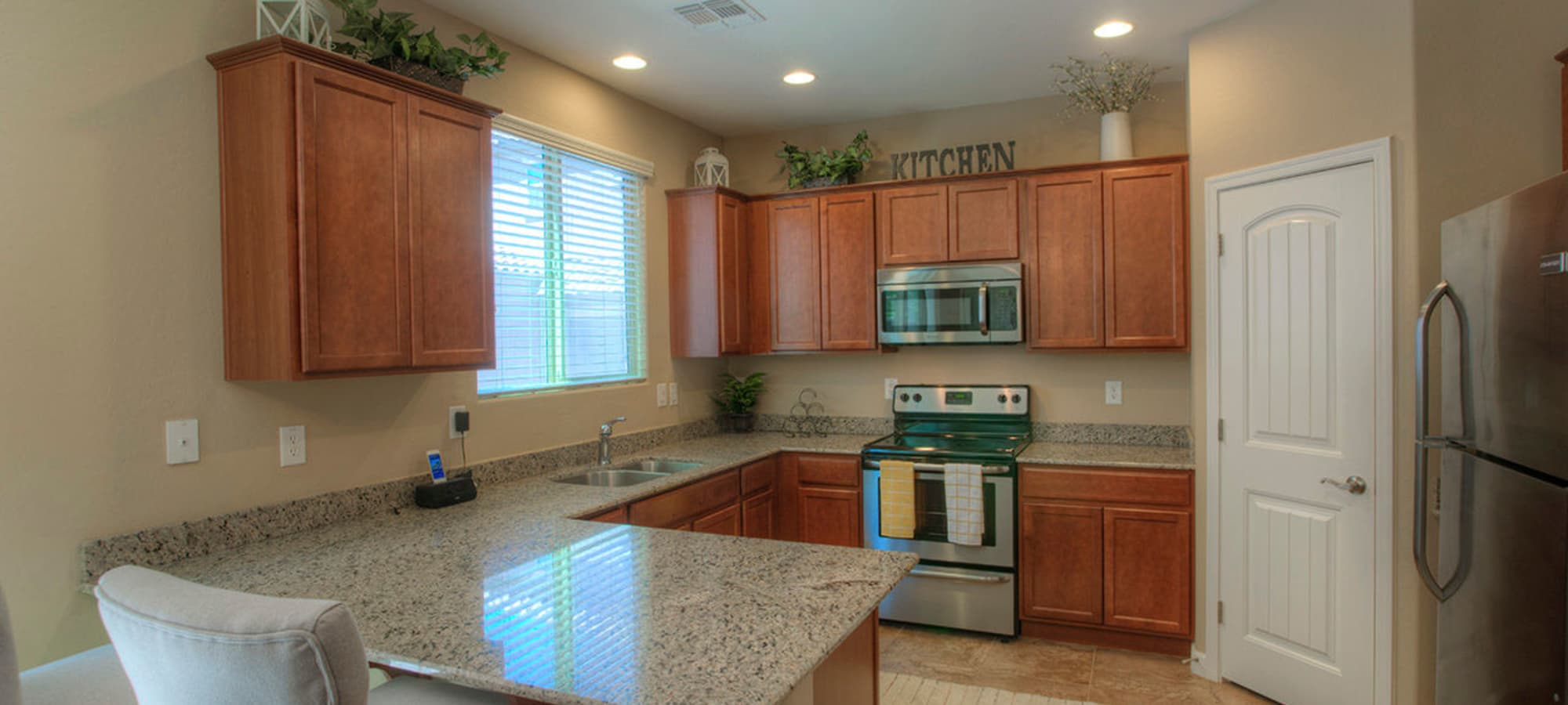 Recessed lighting and stainless steel appliances at BB Living at Higley Park in Gilbert, Arizona