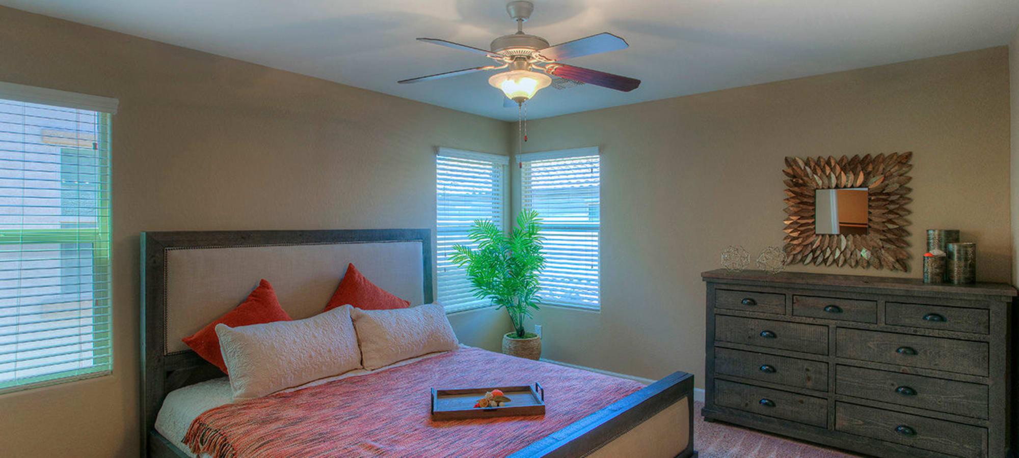 Model master bedroom with ceiling fans at BB Living at Higley Park in Gilbert, Arizona