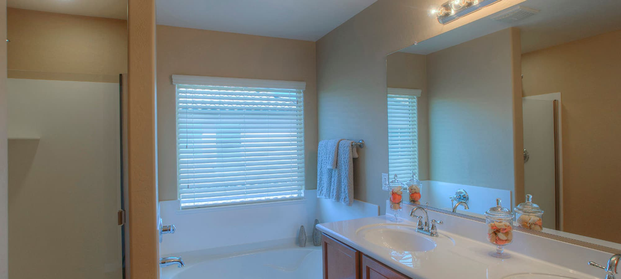 Large bathroom with vanity mirror in model home at BB Living at Higley Park in Gilbert, Arizona