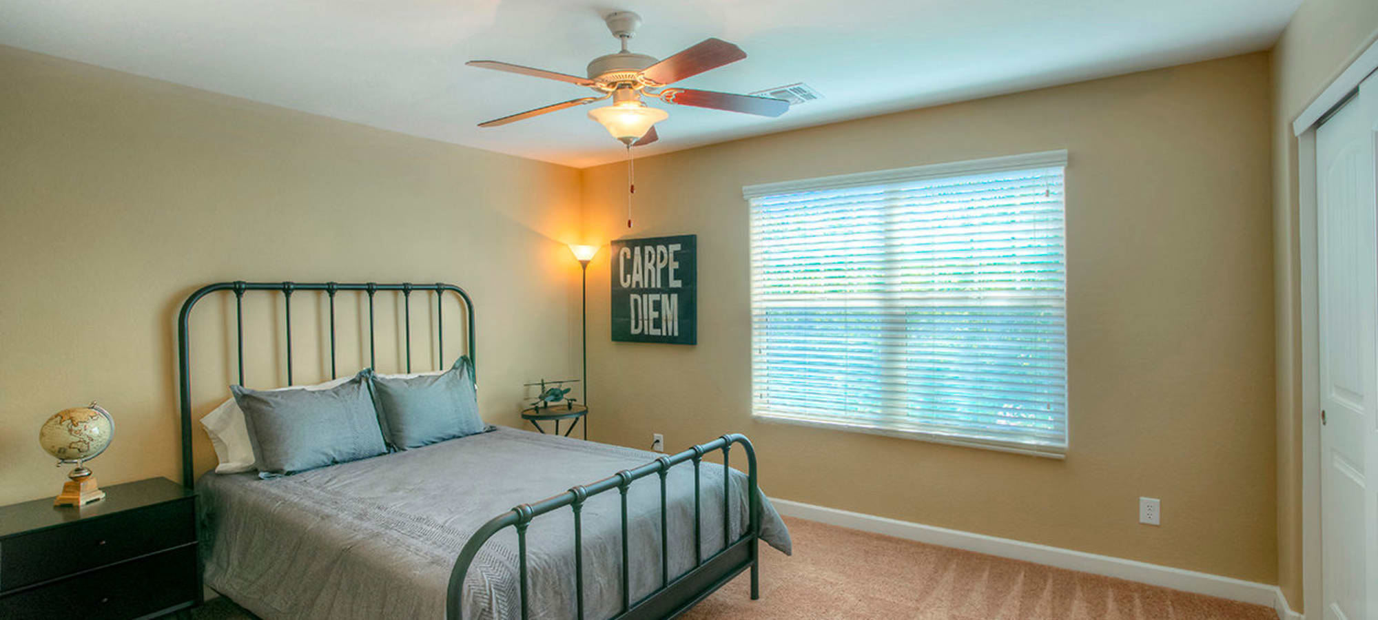 Bedroom with ceiling fan in model home at BB Living at Higley Park in Gilbert, Arizona
