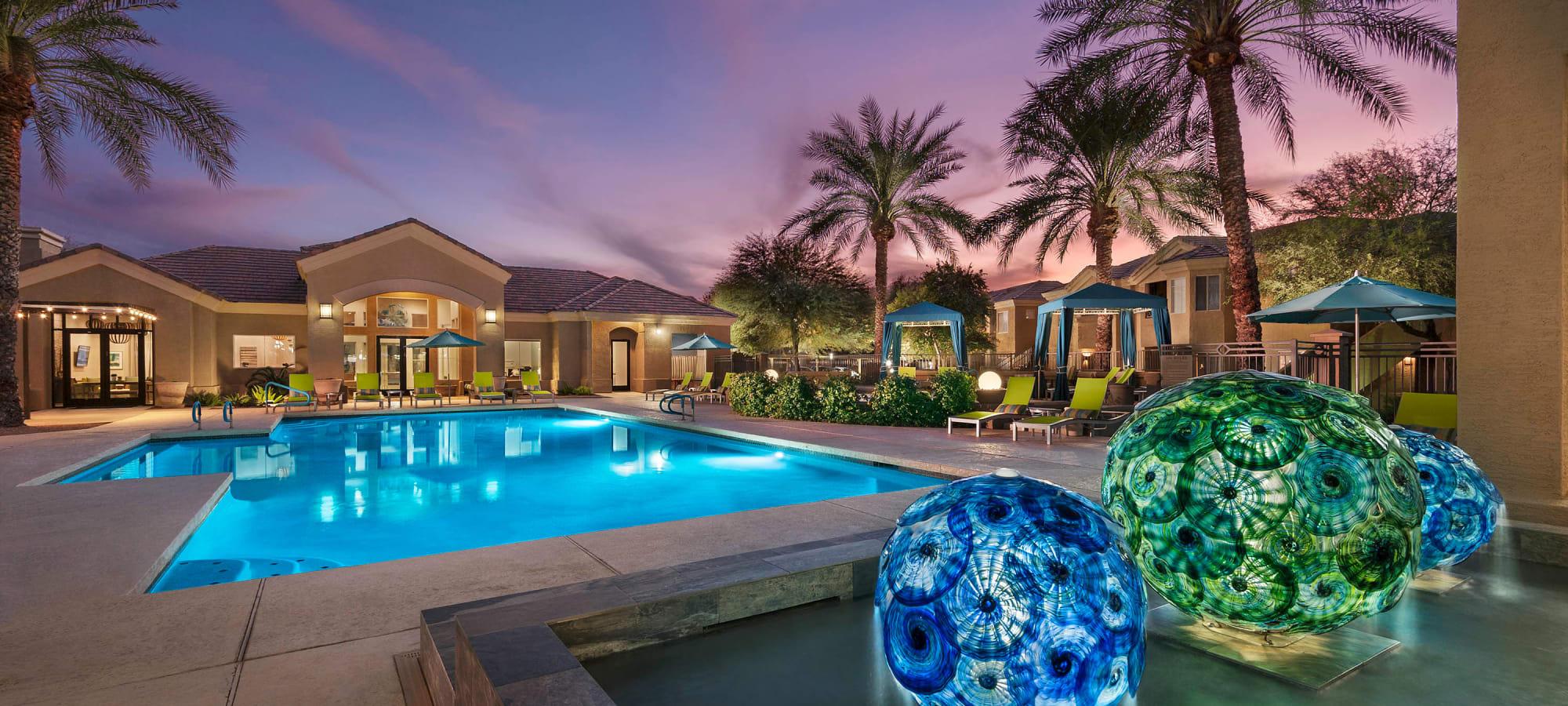 Illuminated decor near the swimming pool at dusk at Mira Santi in Chandler, Arizona
