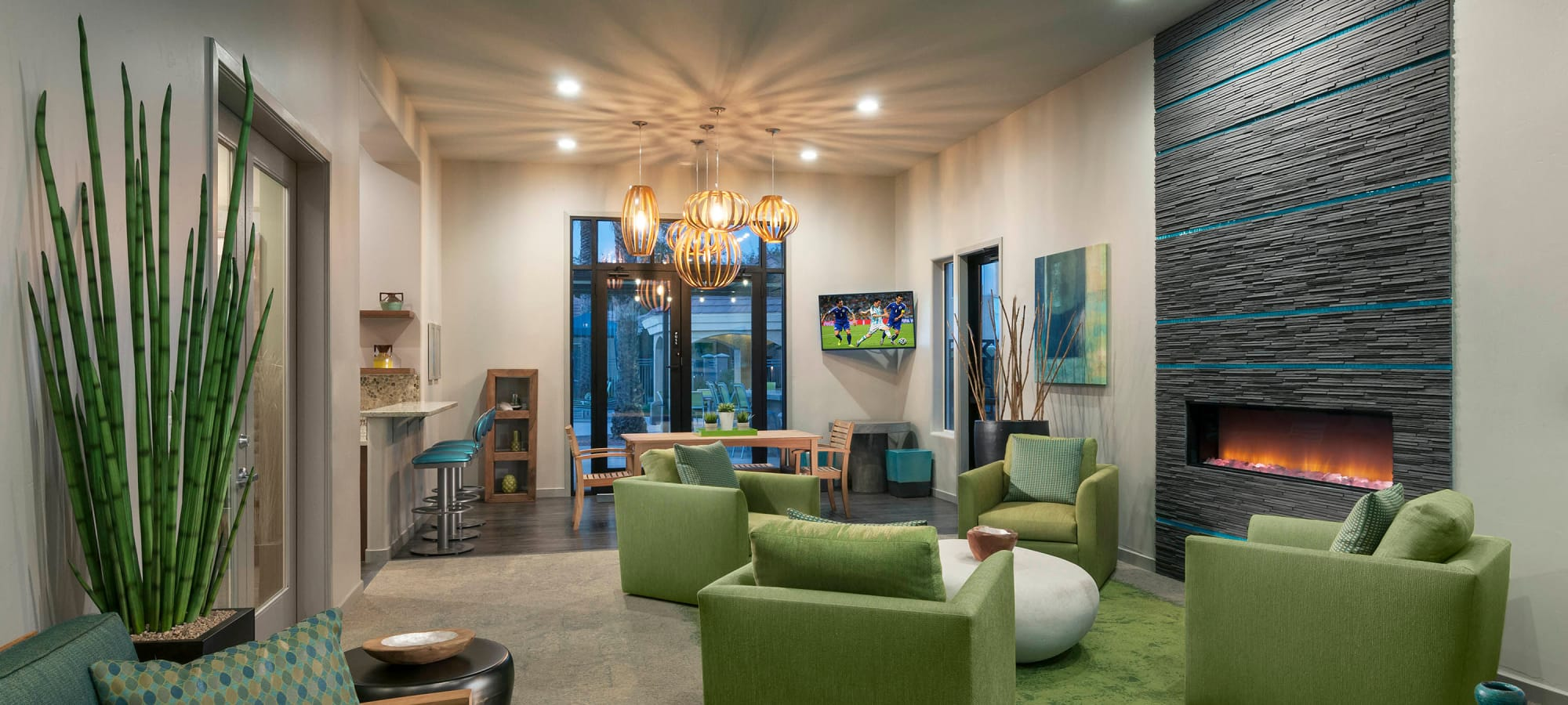 Comfortable seating in front of the fireplace in the resident clubhouse at Mira Santi in Chandler, Arizona