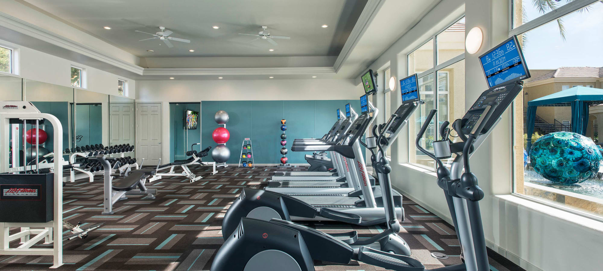 Well-equipped fitness center at Mira Santi in Chandler, Arizona