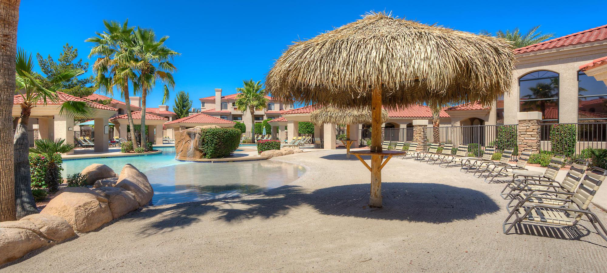 Poolside grass umbrellas at San Lagos in Glendale, Arizona