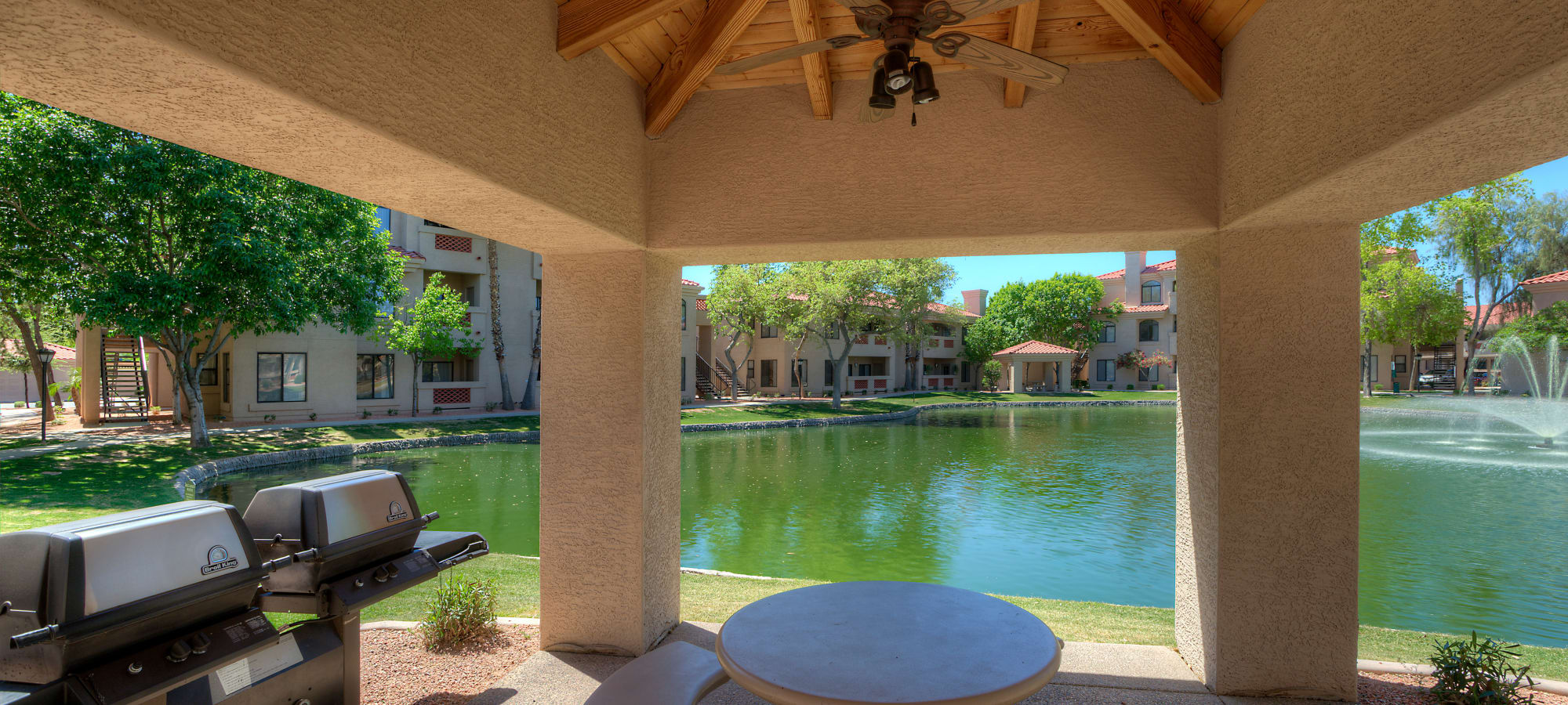 Covered picnic area next to a pond at San Lagos in Glendale, Arizona