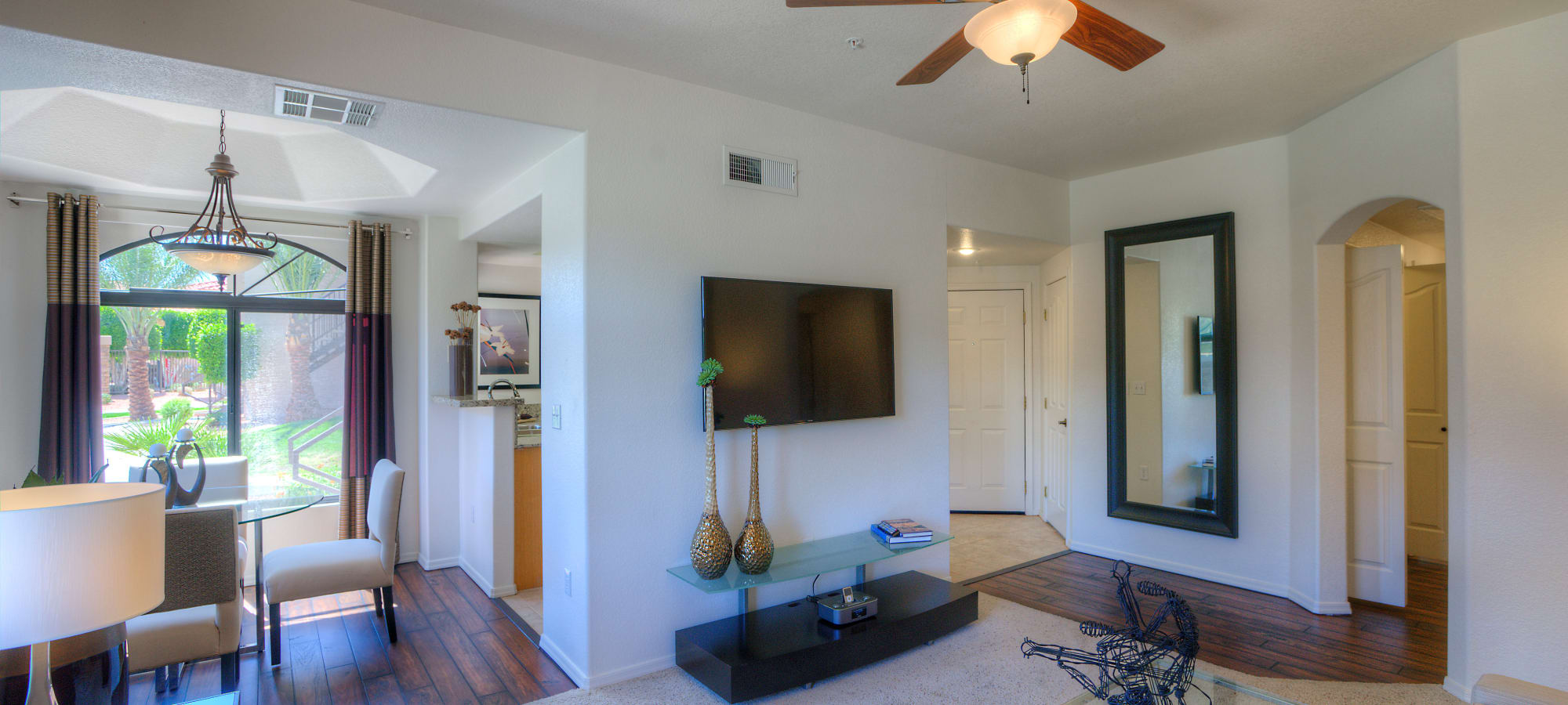 Living room with sliding glass door at San Lagos in Glendale, Arizona