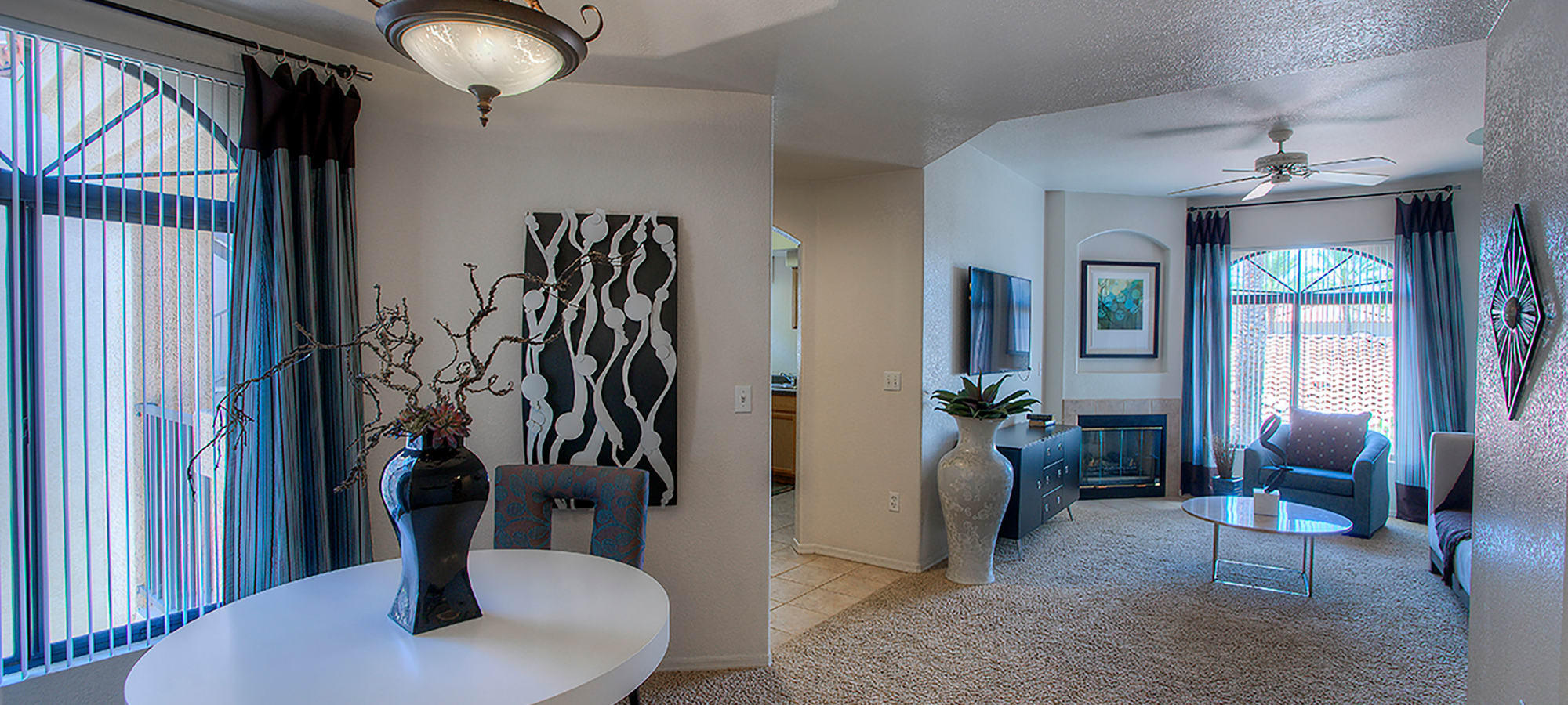 View of the living area from the dining room of a model home at San Pedregal in Phoenix, Arizona